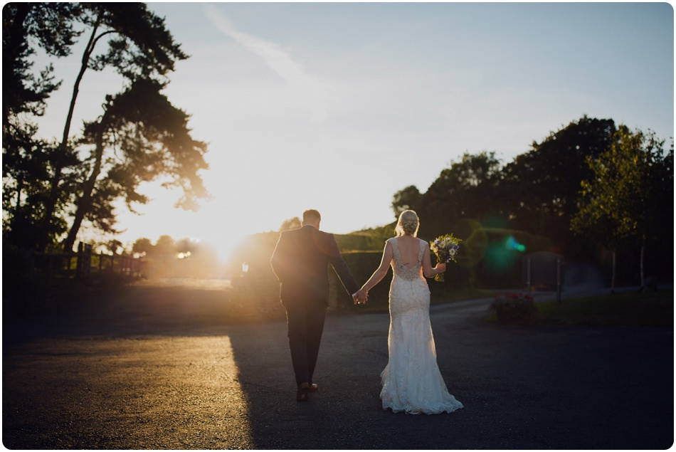 couple in golden hour at kingscote barn in tetbury