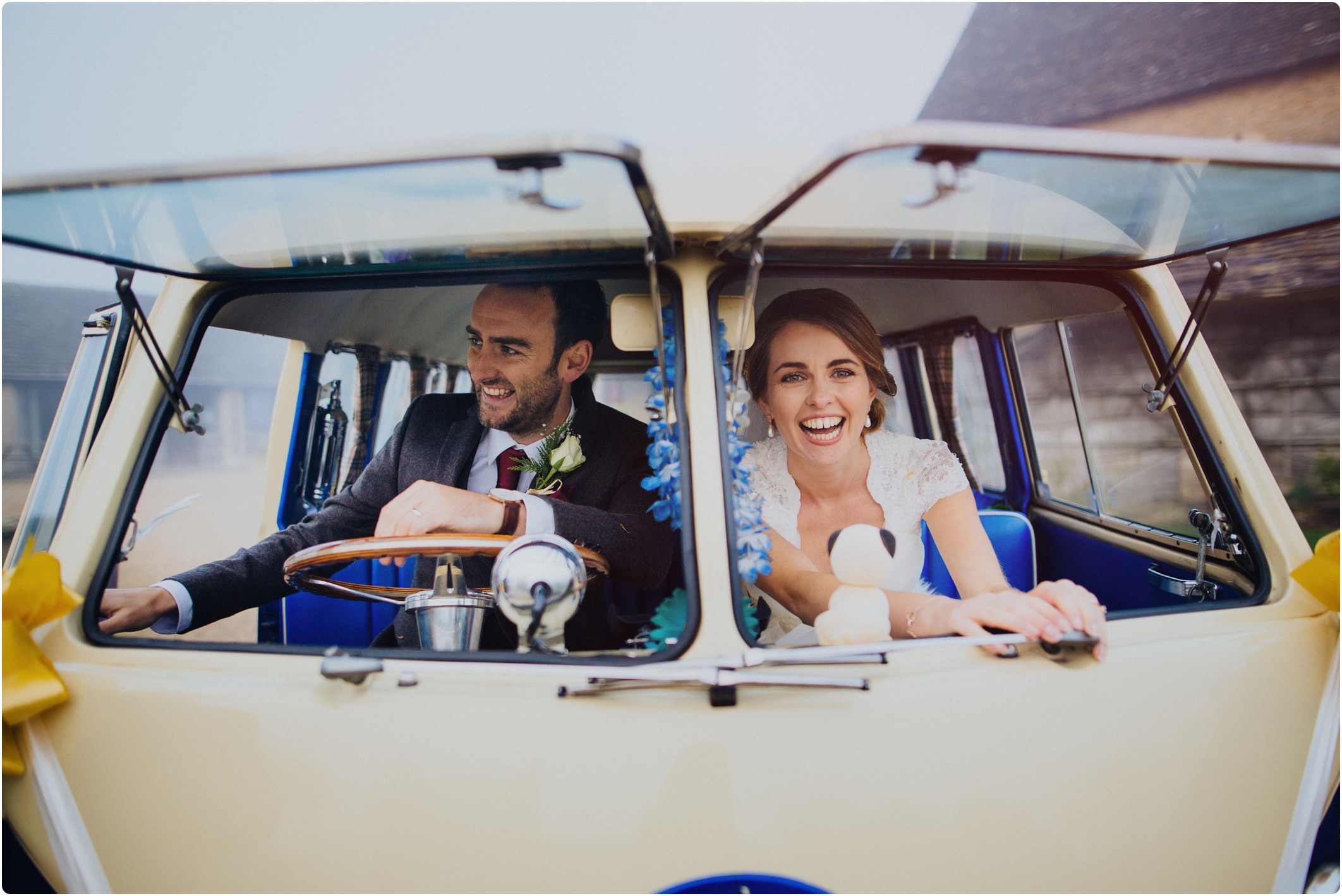 blue and white vw camper at wedding