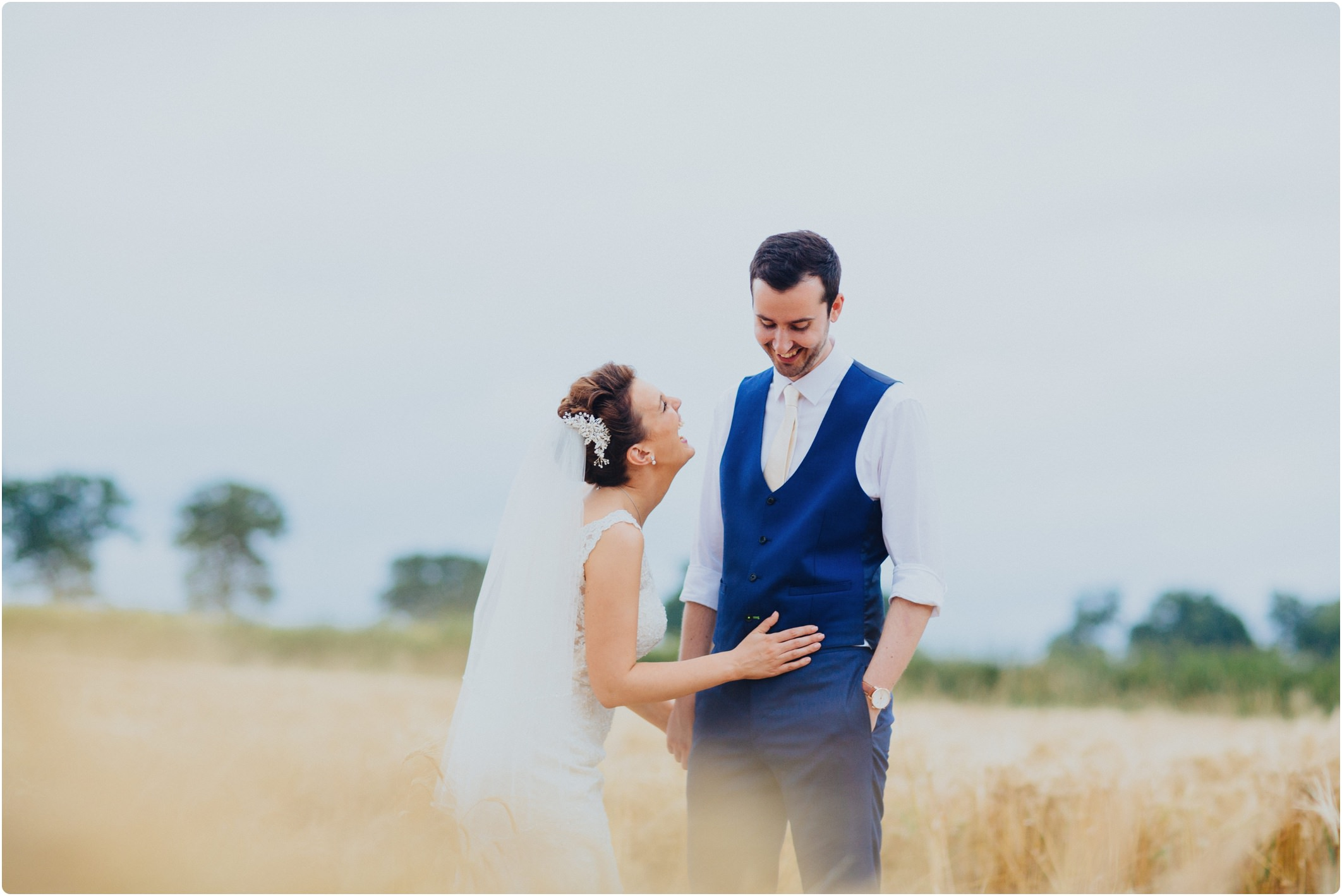 Swallows Nest Barn wedding couple shoot in field