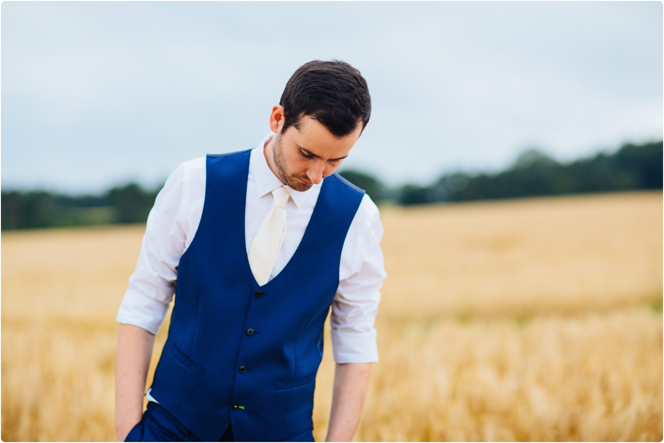 Groom with waistcoat and rolled up sleeves
