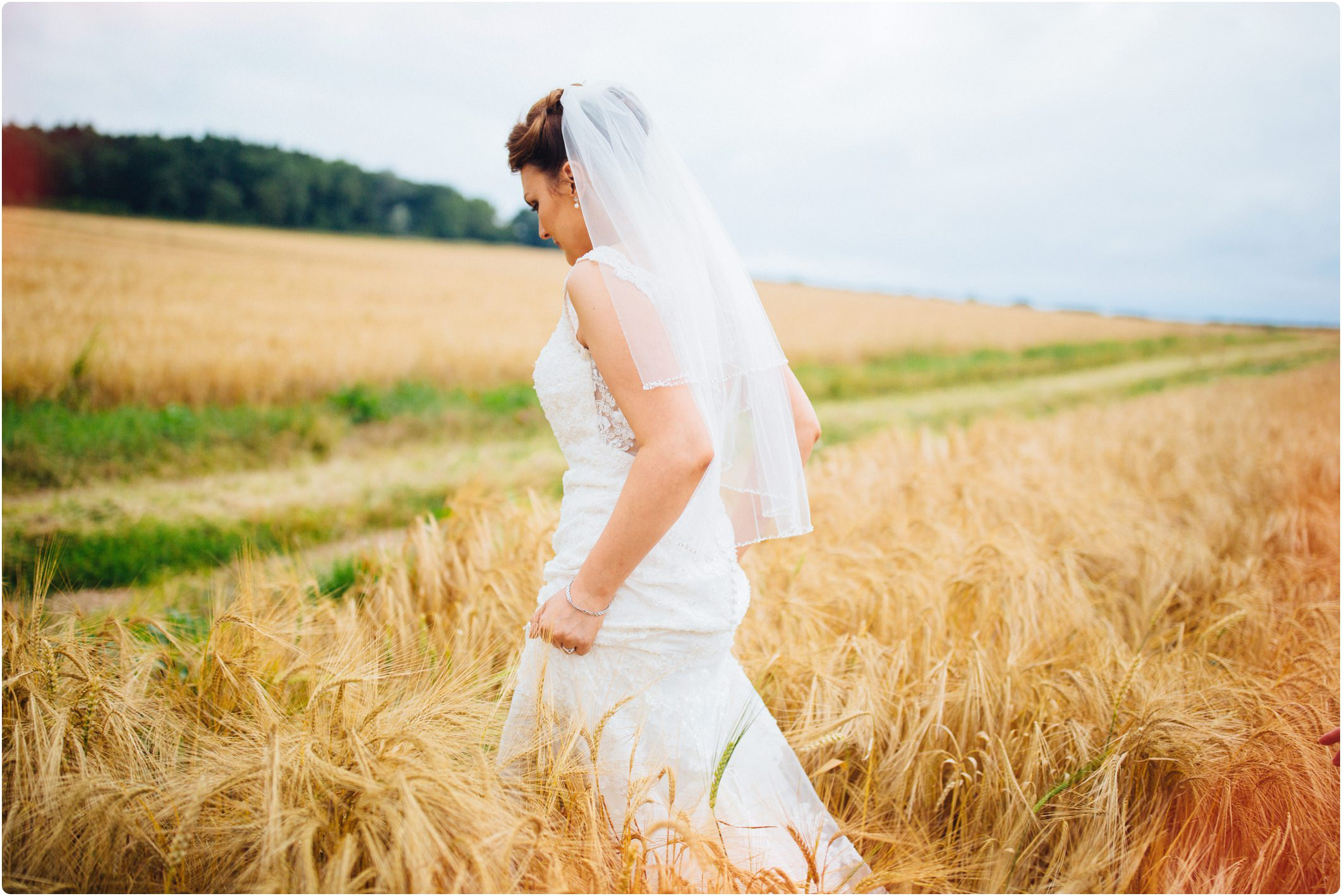 Swallows Nest Barn bride walking through field