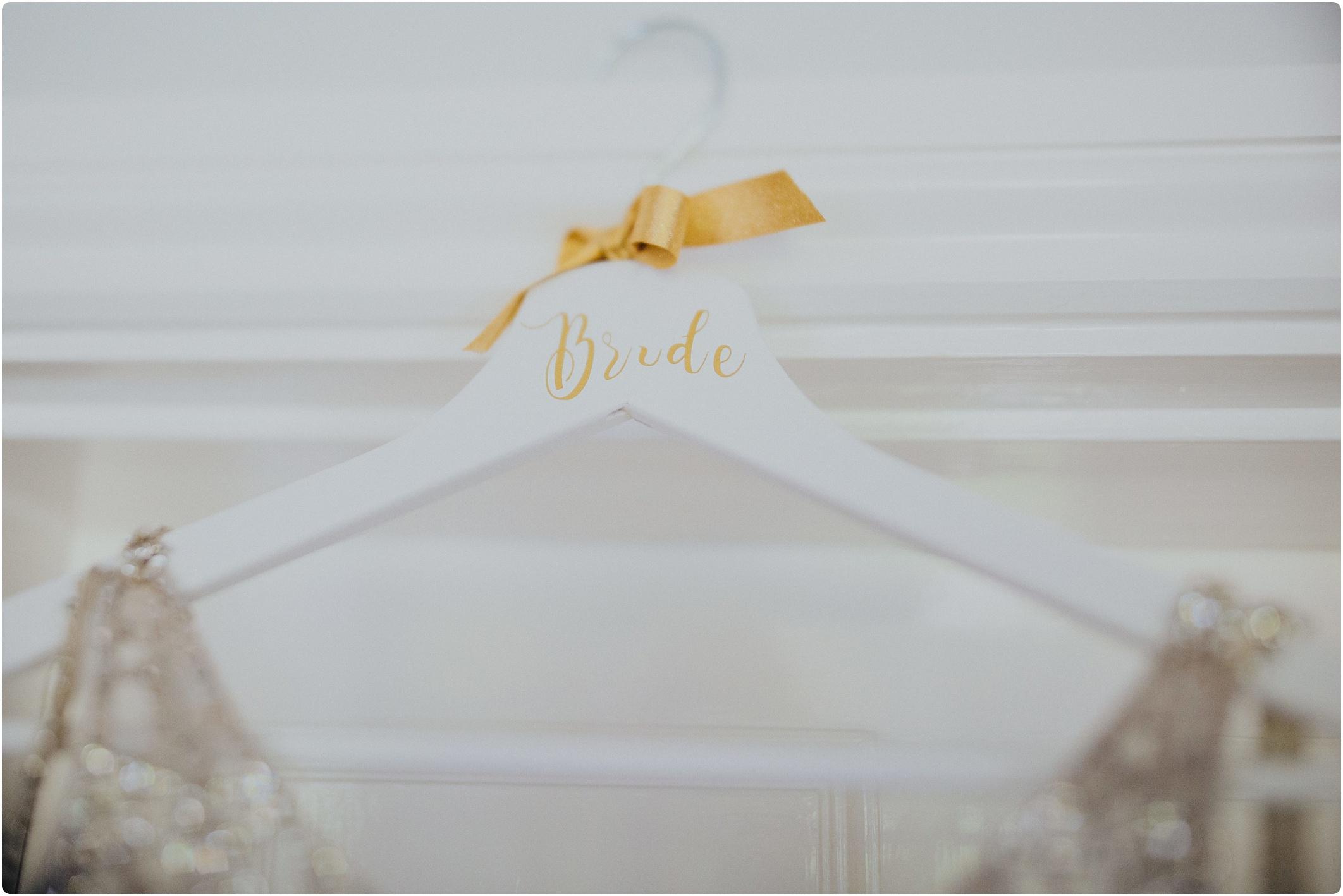 gold written bride hanger