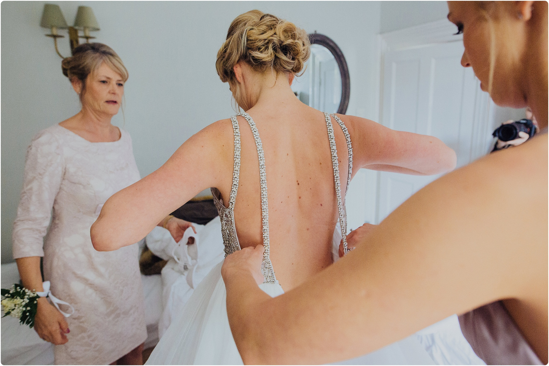 bride getting in hayley paige dress