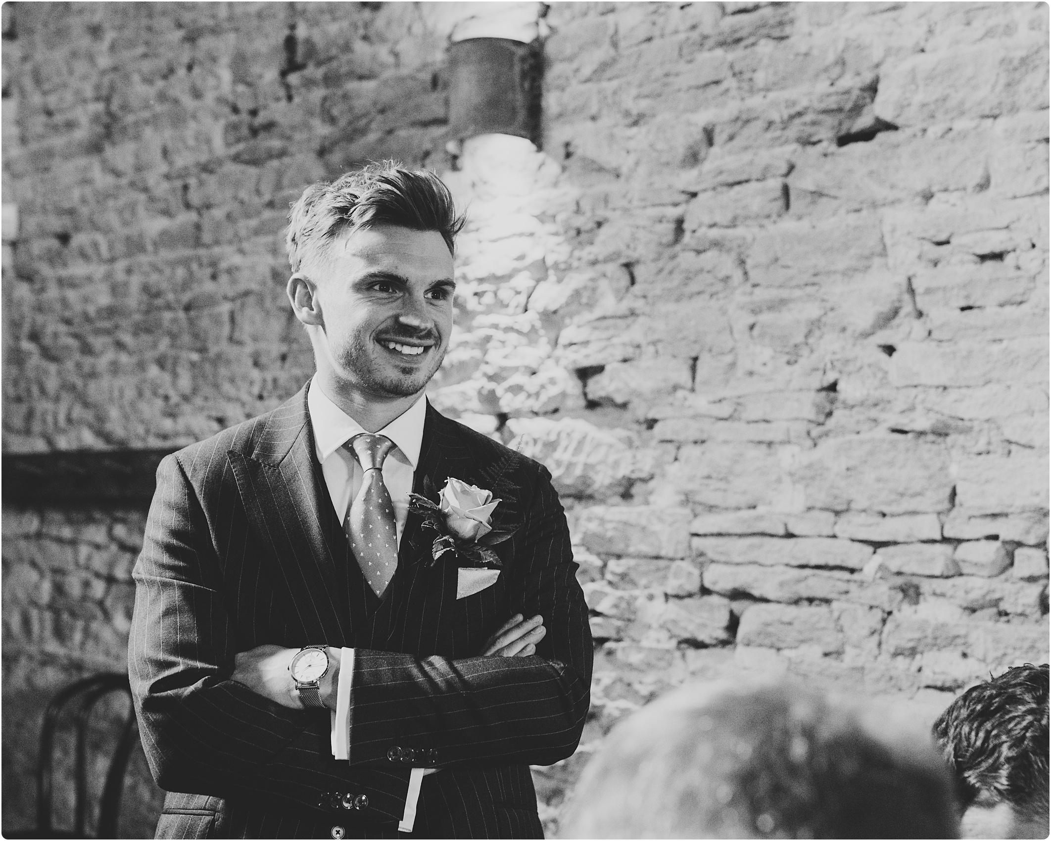 pin stripe groom at Cripps Barn