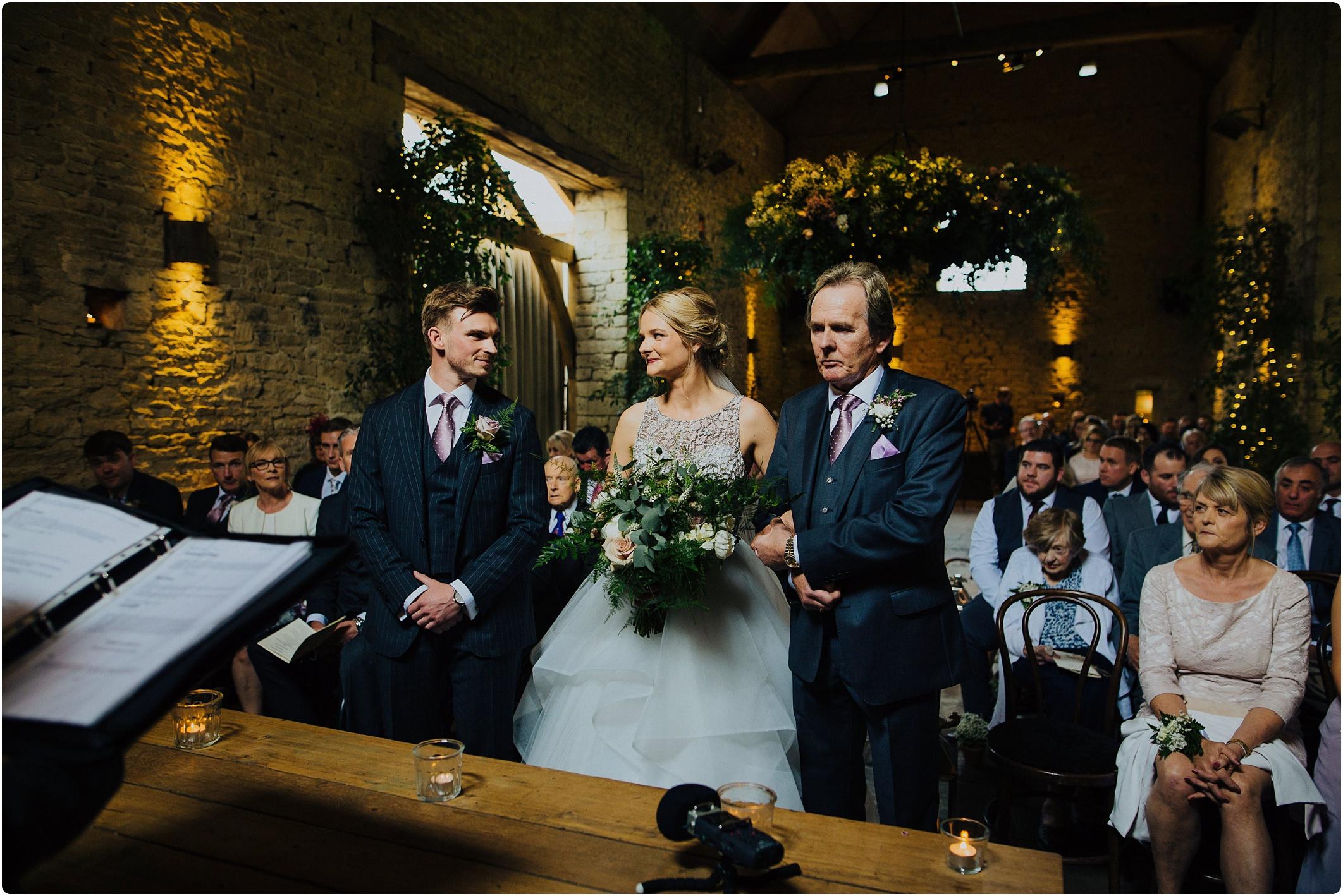 Cripps Barn wedding bride and groom look