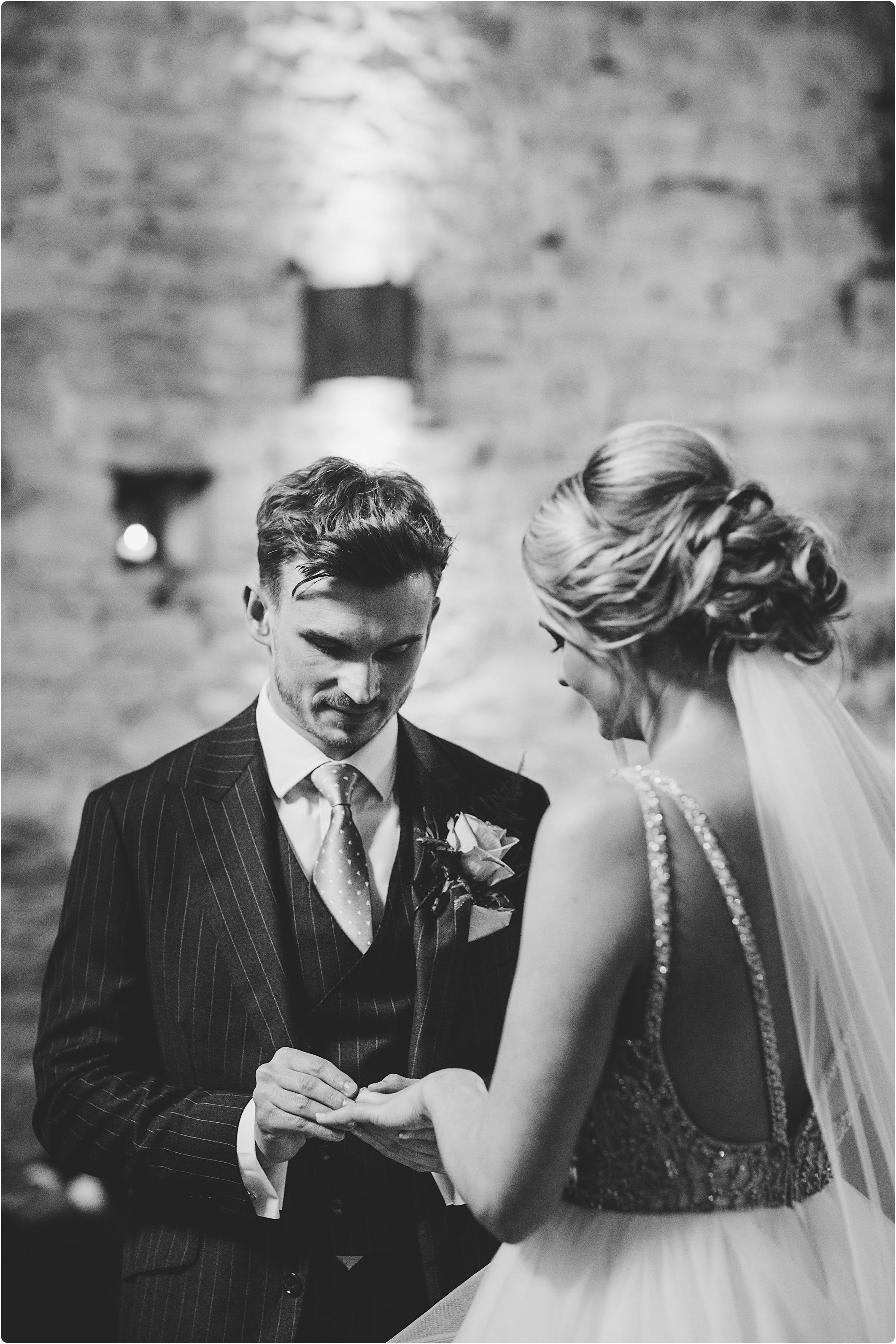 Cripps Barn groom putting ring on