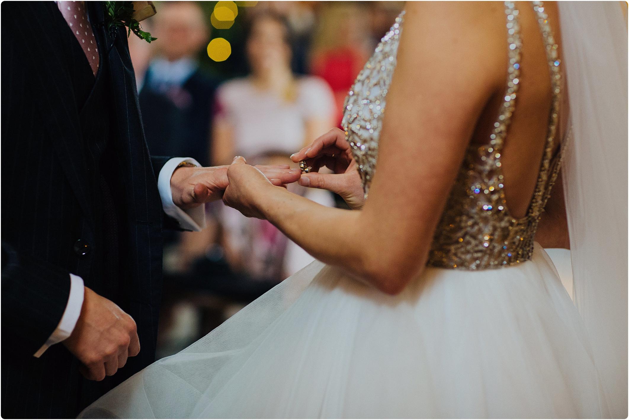 Cripps Barn bride putting ring on