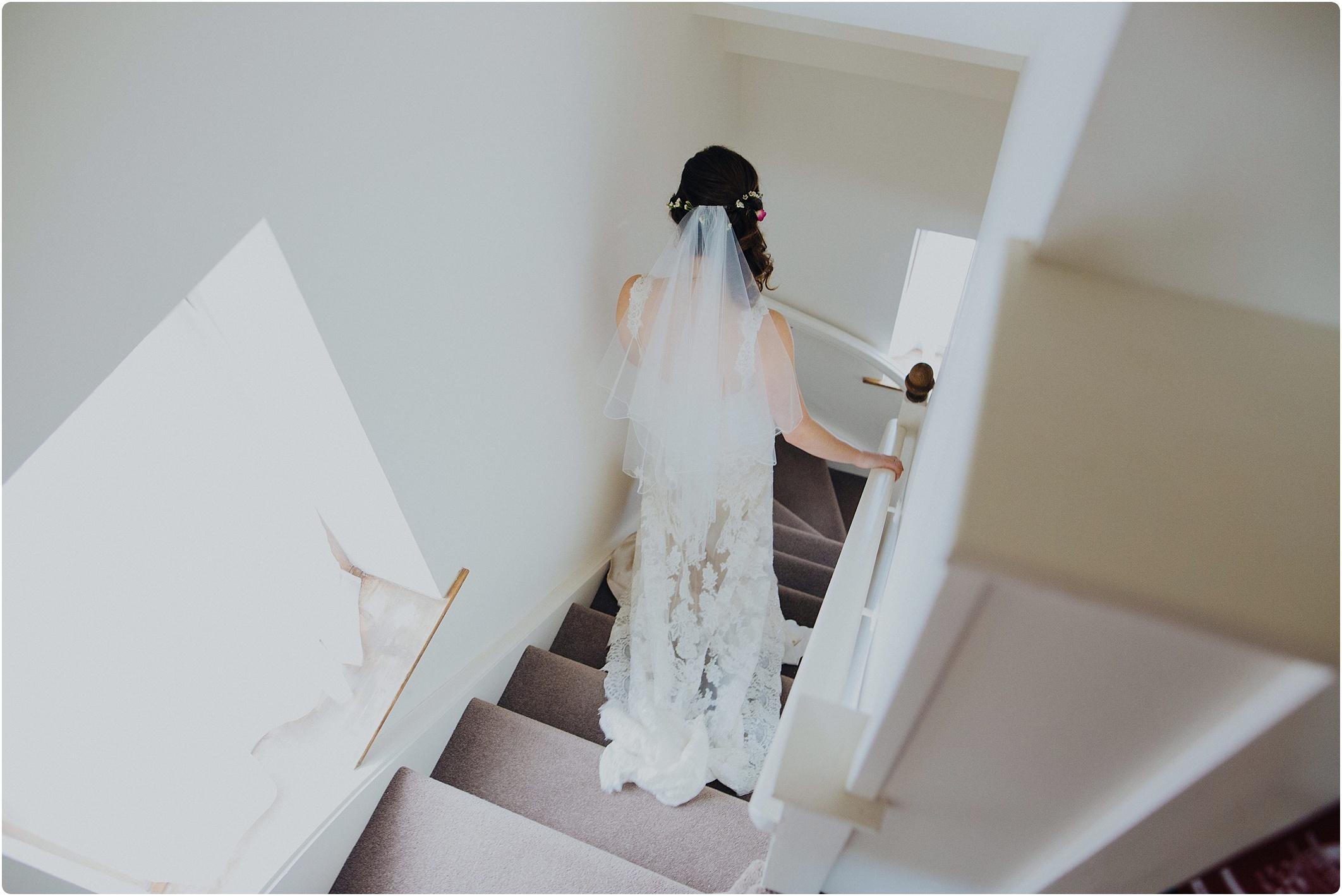 Treadam Barn Wedding bride going down steps