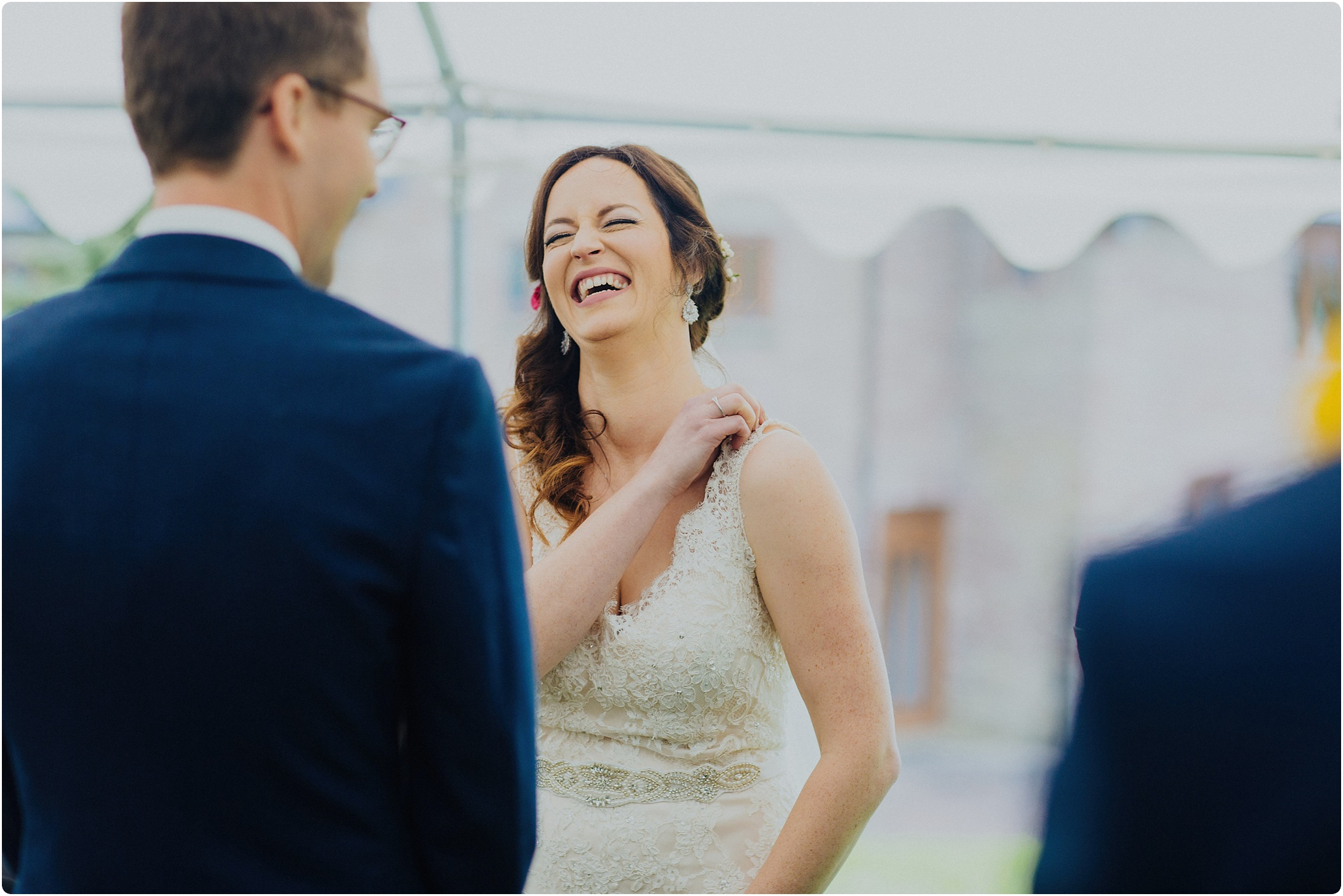 bride laughing in ceremony