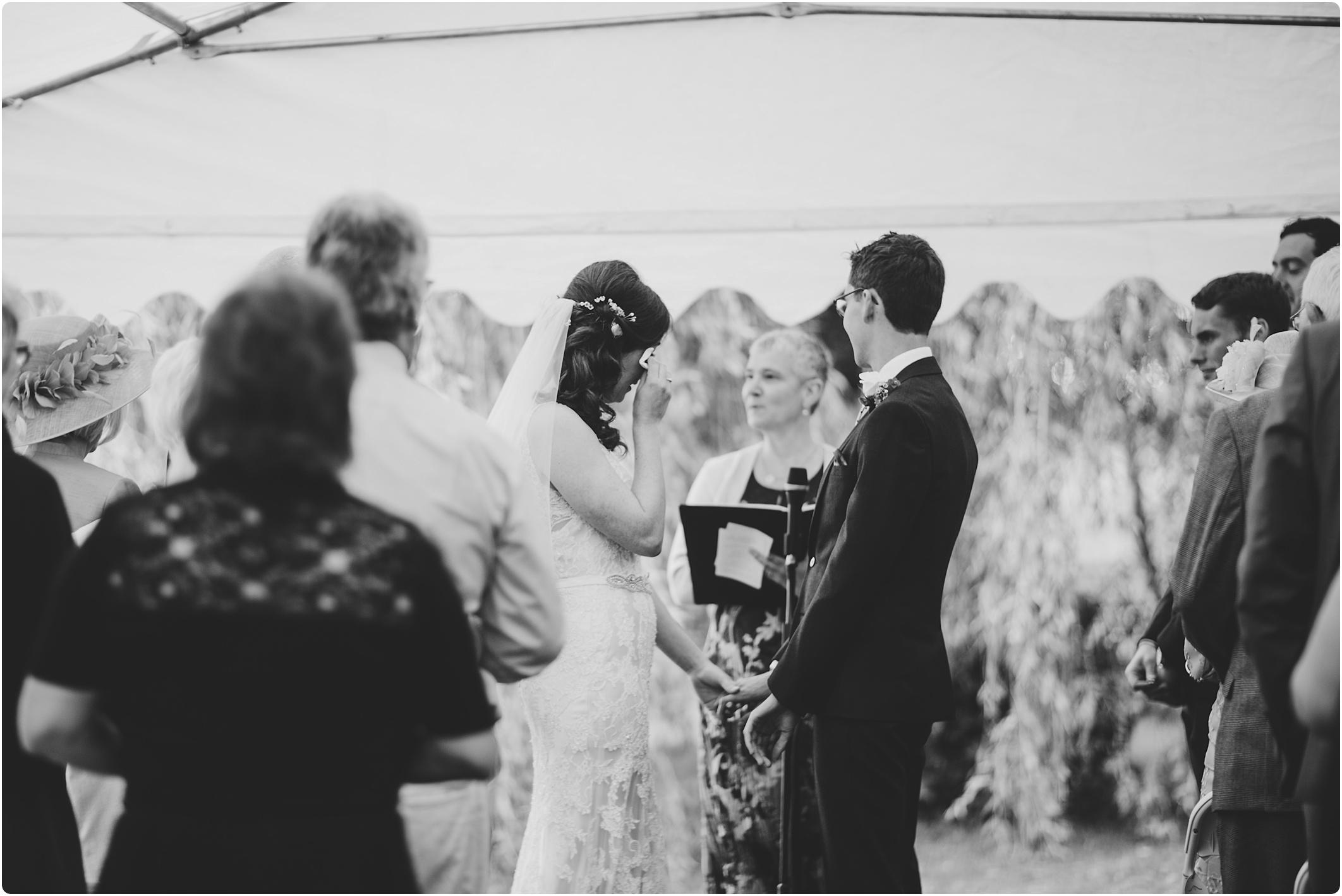 welsh wedding, bride wiping a tear away