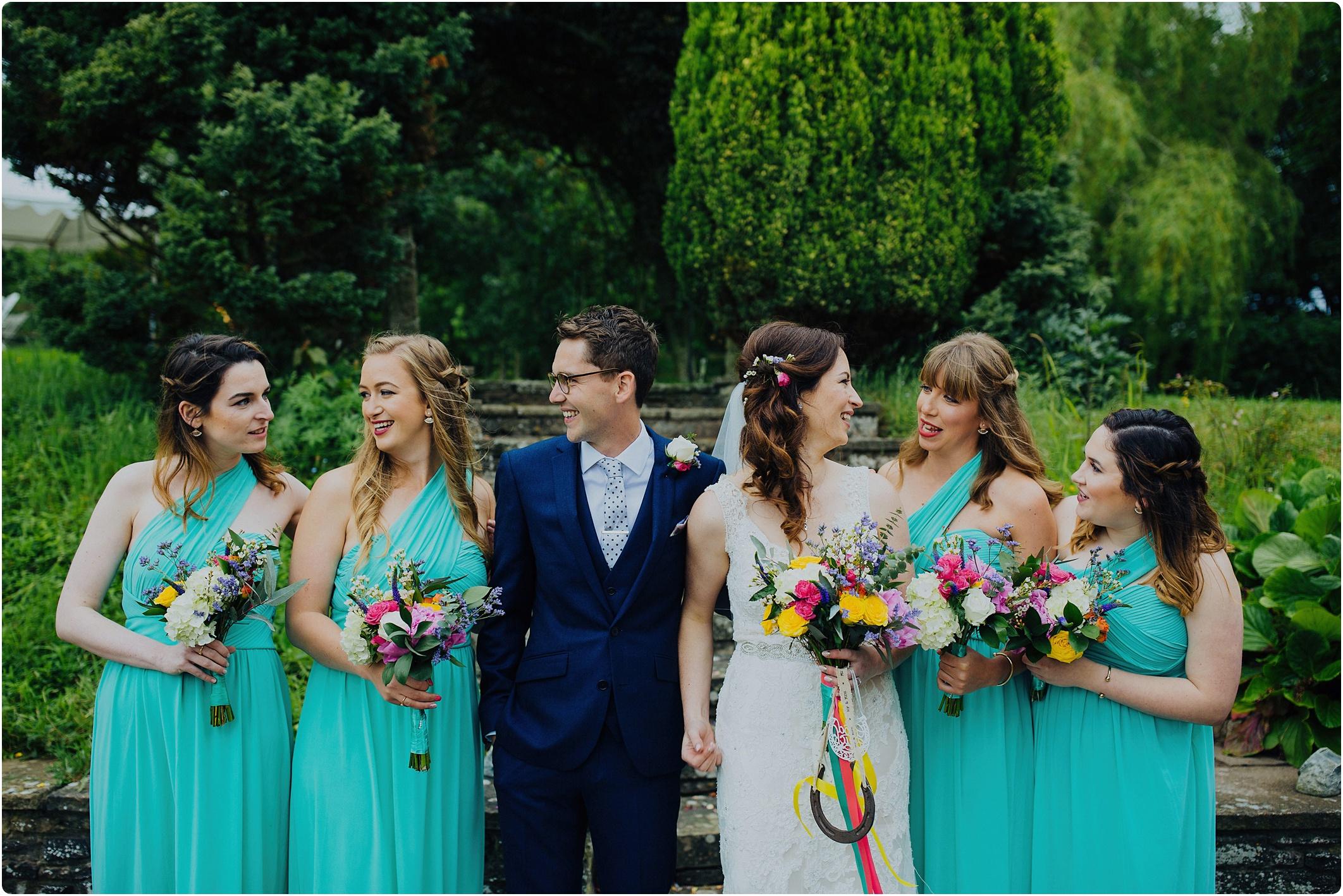 Treadam Barn Wedding groom with bridesmaids