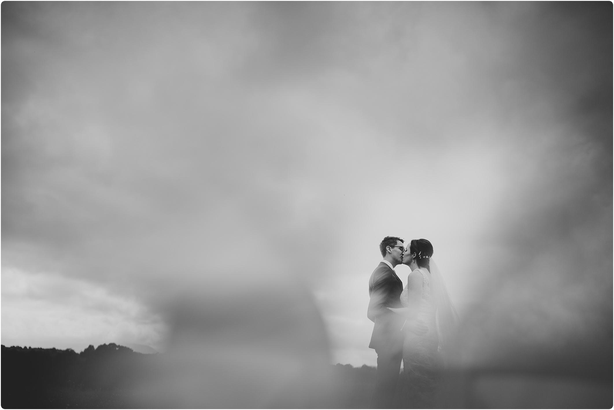 couple shot in field