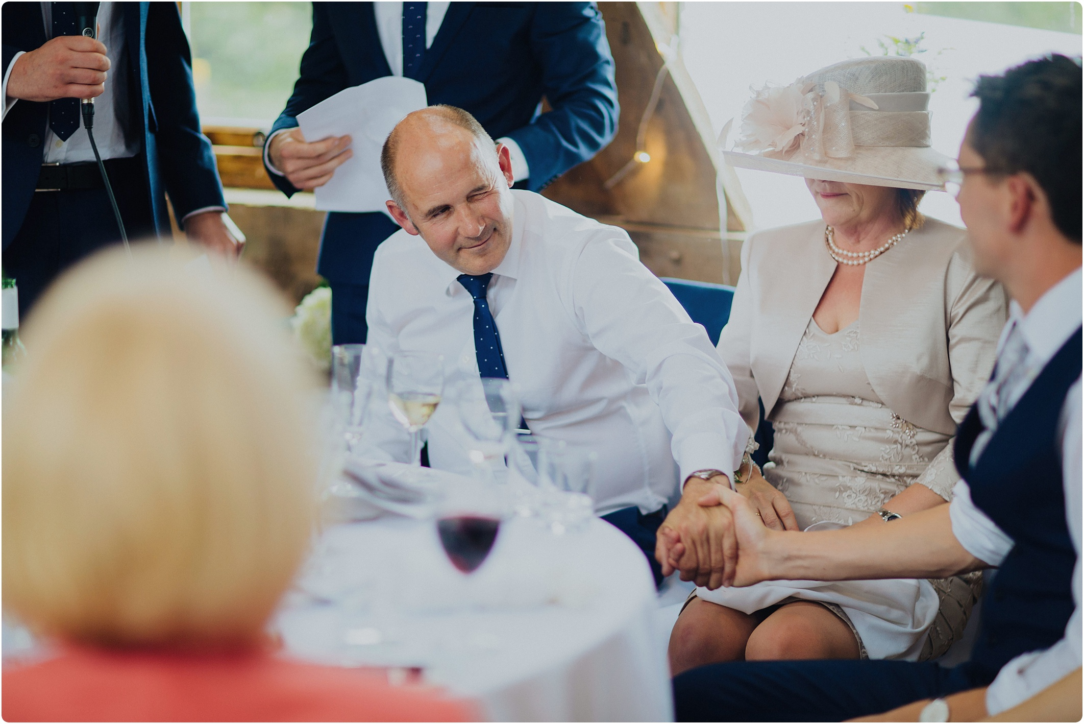 Treadam Barn Wedding after speeches father of groom squeezes hand