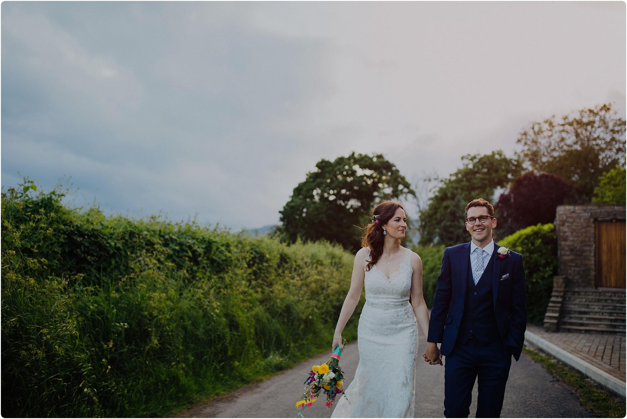 Treadam Barn Wedding bride and groom walking up lane