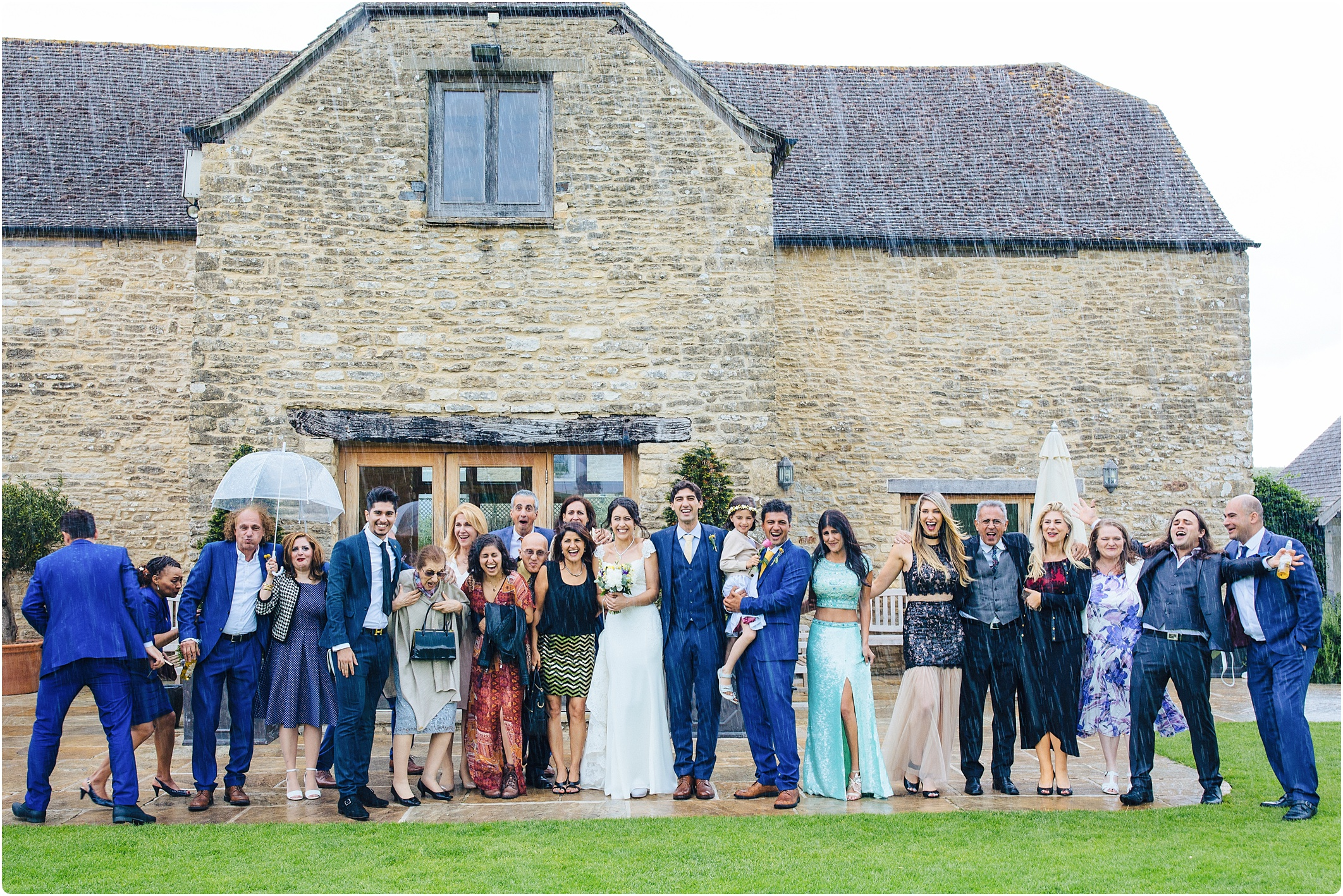 group shot in the rain at kingscote barn