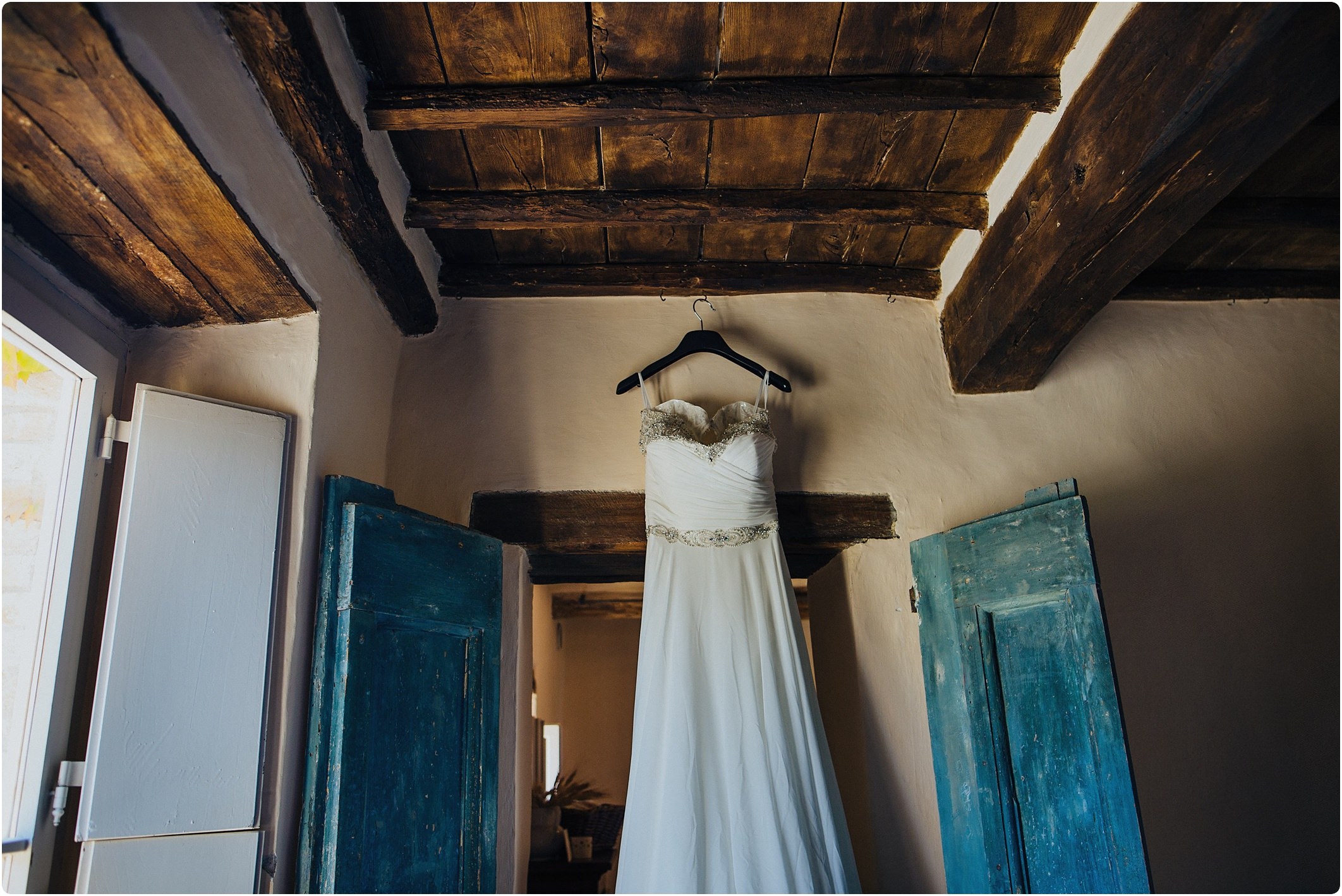 rustic italian doors with justin alexander dress hanging up