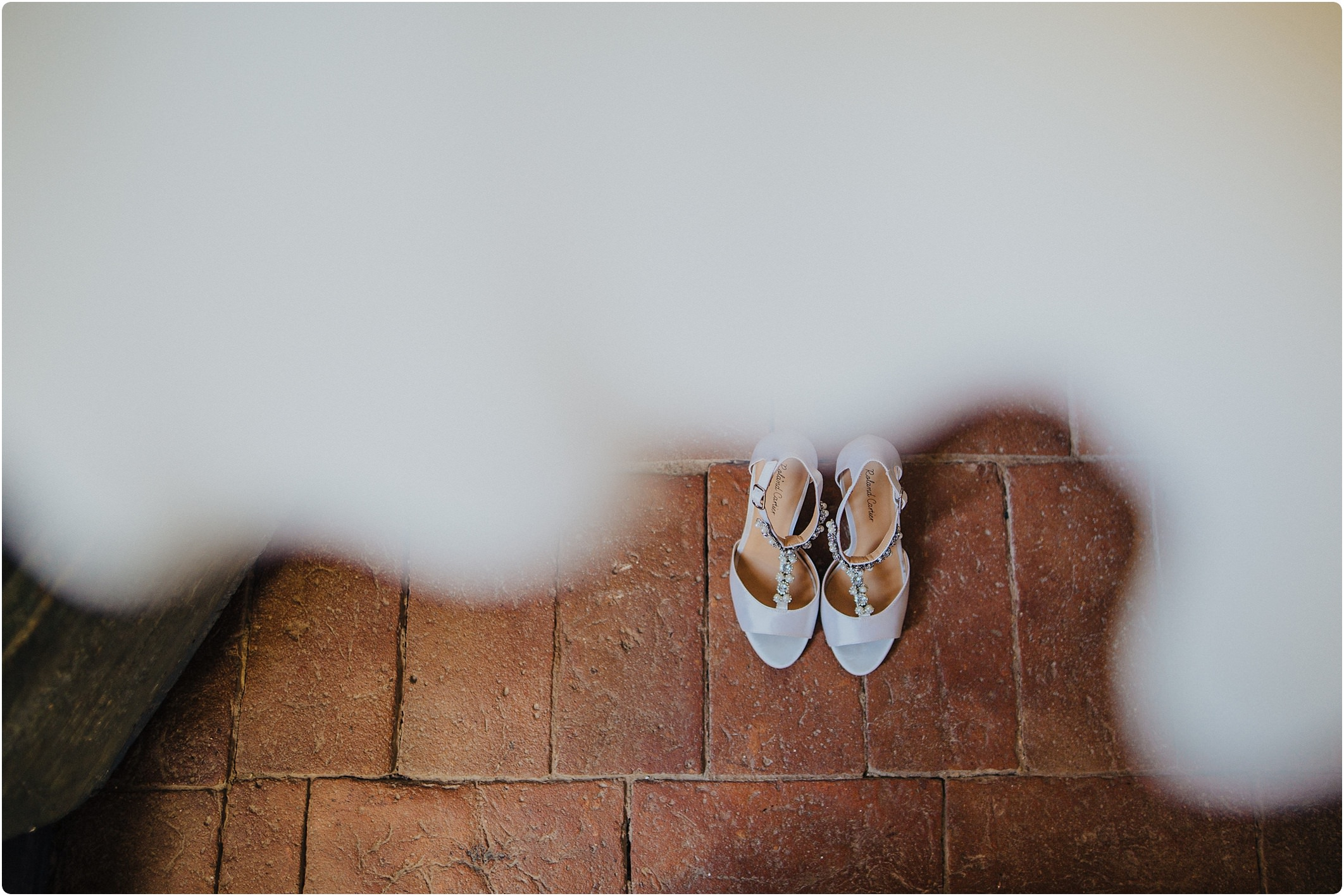 shoes and justine alexander dress at a tuscan wedding