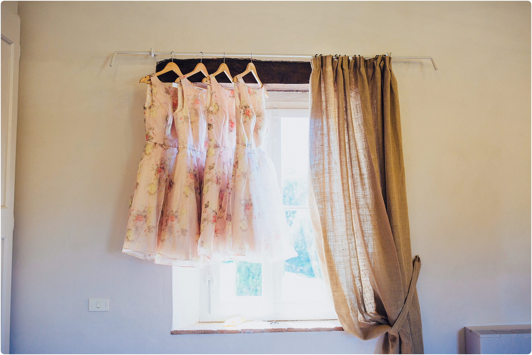 floral bridesmaids dresses hanging up at villa podernovo