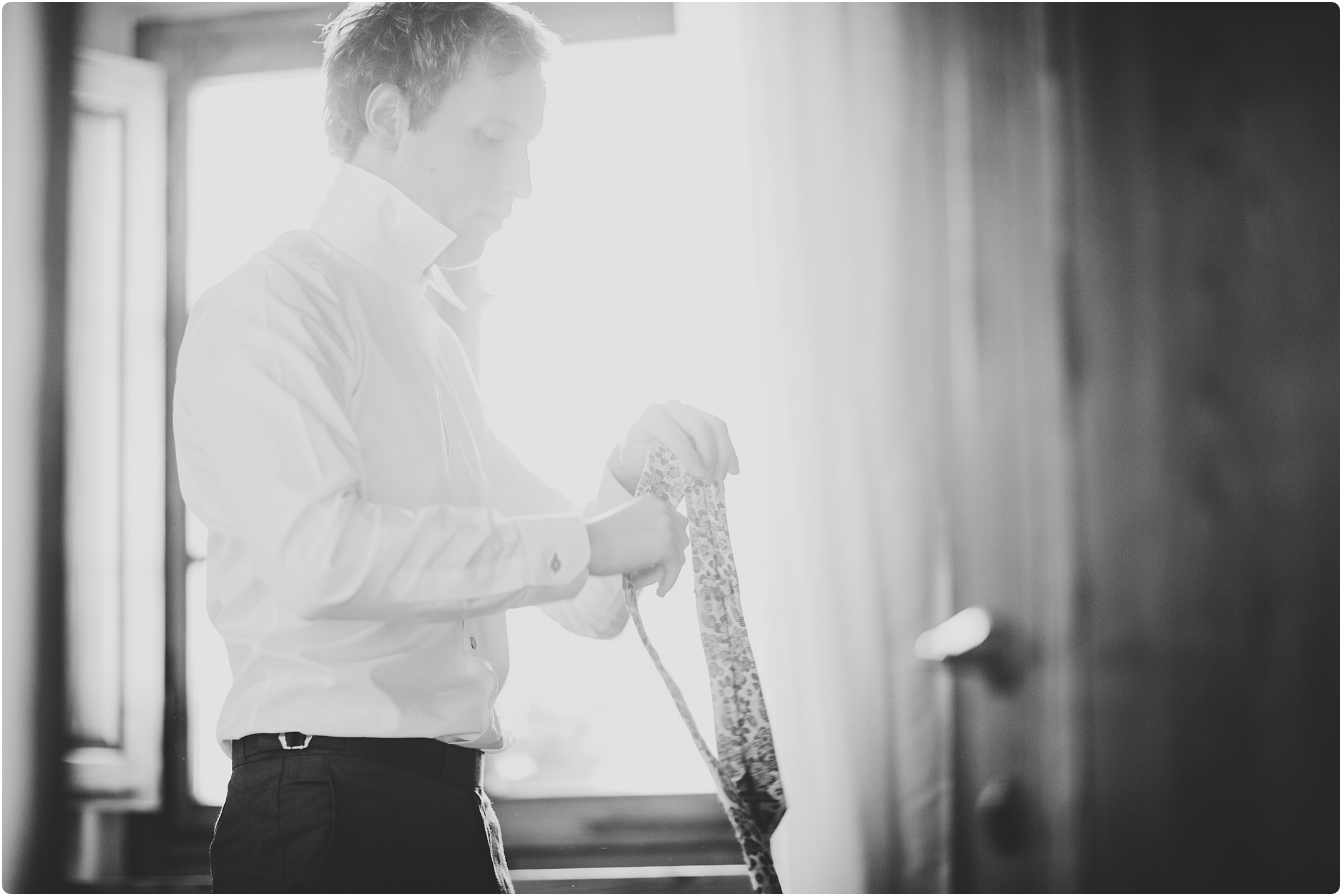 groom getting ready at a tuscan wedding