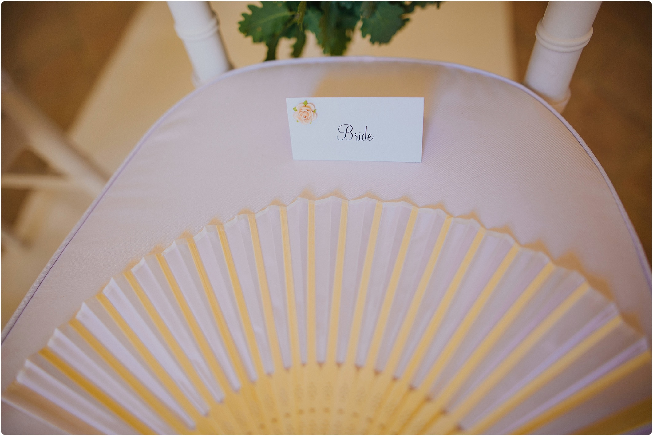 tuscan wedding with brides chair and fan