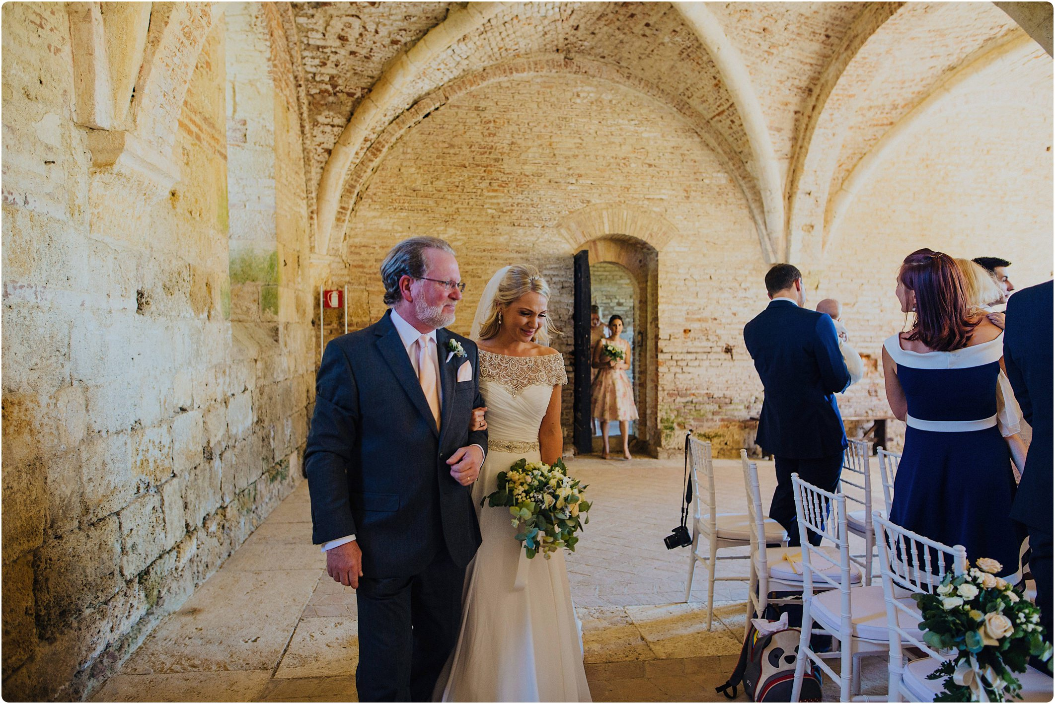 father walking bride down aisle at a san galgano abbey wedding