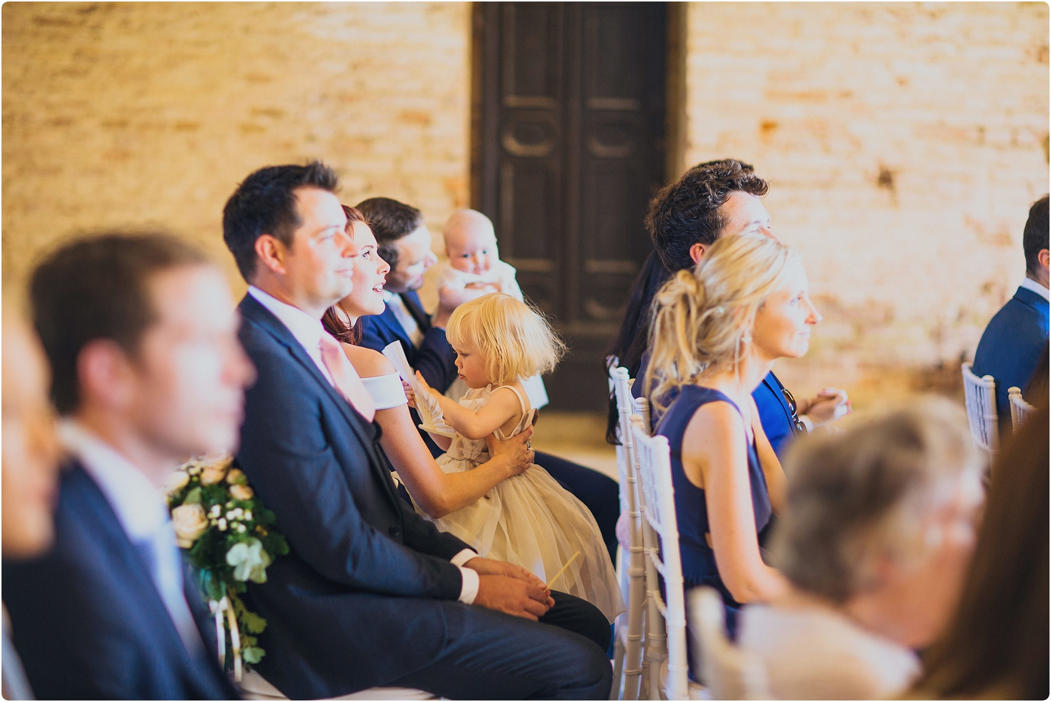 flower girl playing at a san galgano abbey wedding