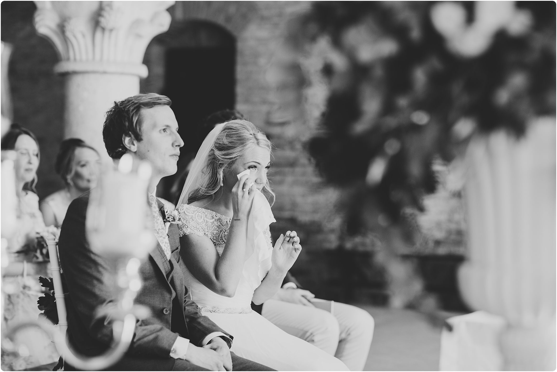 bride wiping a tear at a san galgano abbey wedding