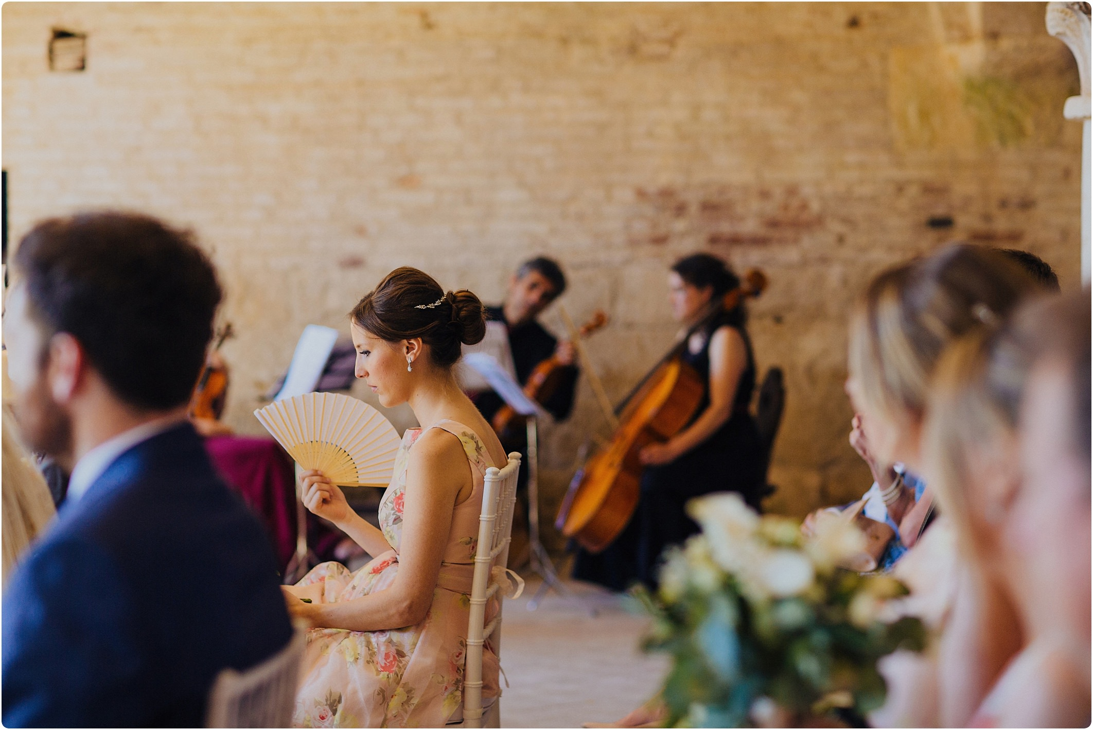 bridesmaid fanning at a san galgano abbey wedding