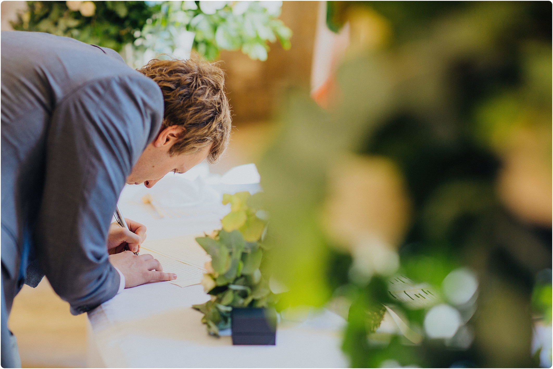 groom signing papers at a san galgano abbey wedding