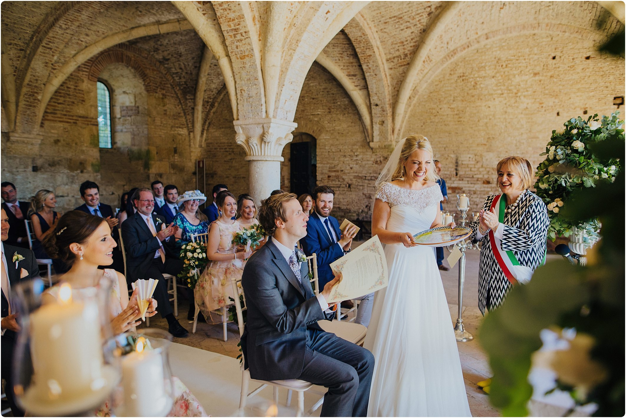 bride getting a gift at a san galgano abbey wedding