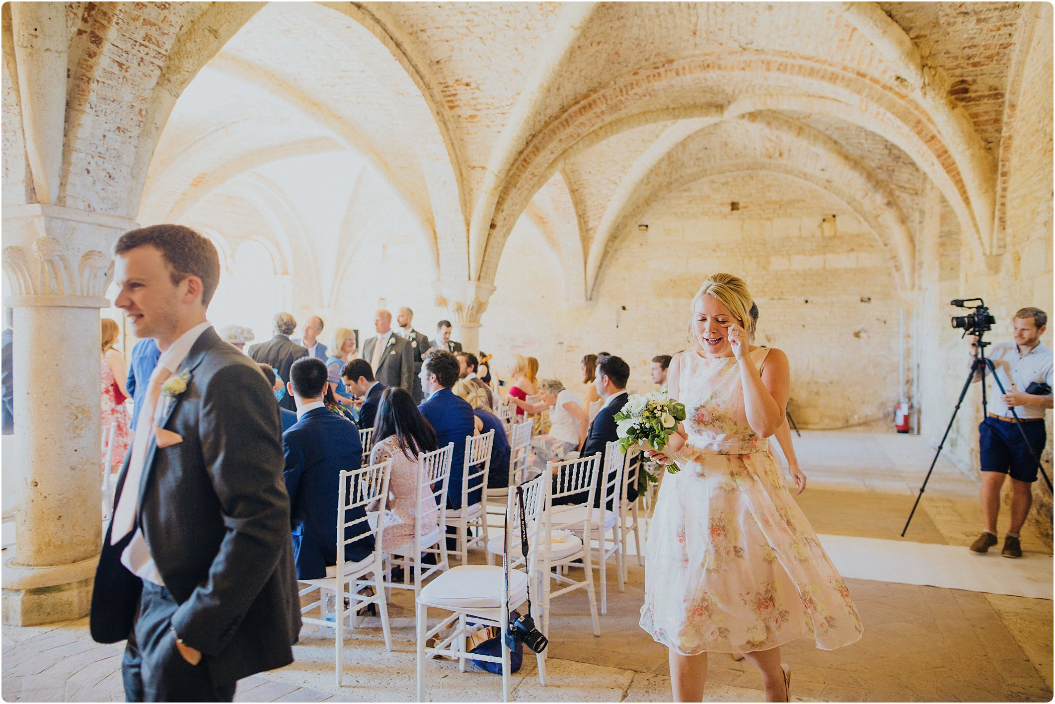 bridesmaid wiping a tear away at a san galgano abbey wedding