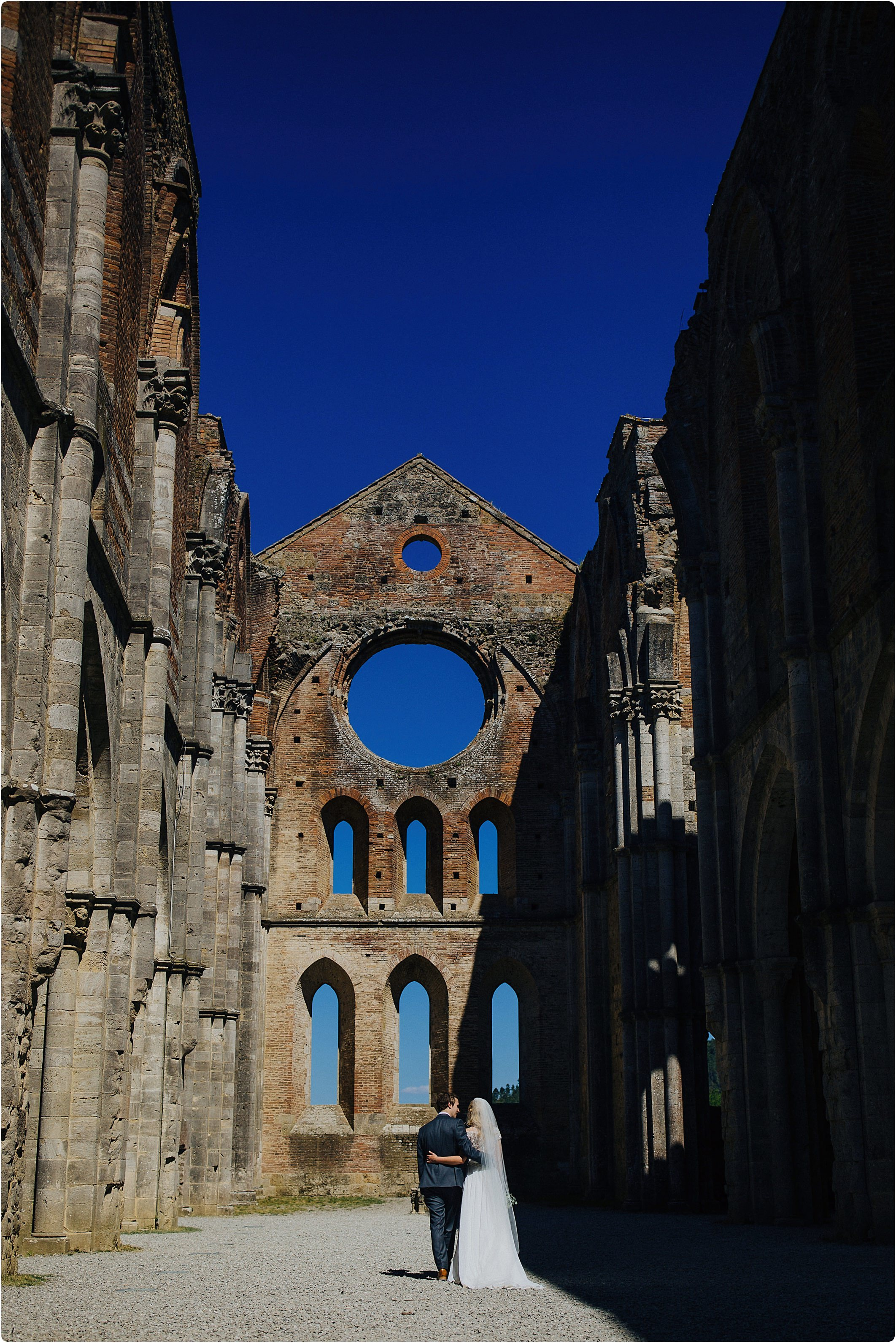 couple in an empty san galgano abbey wedding