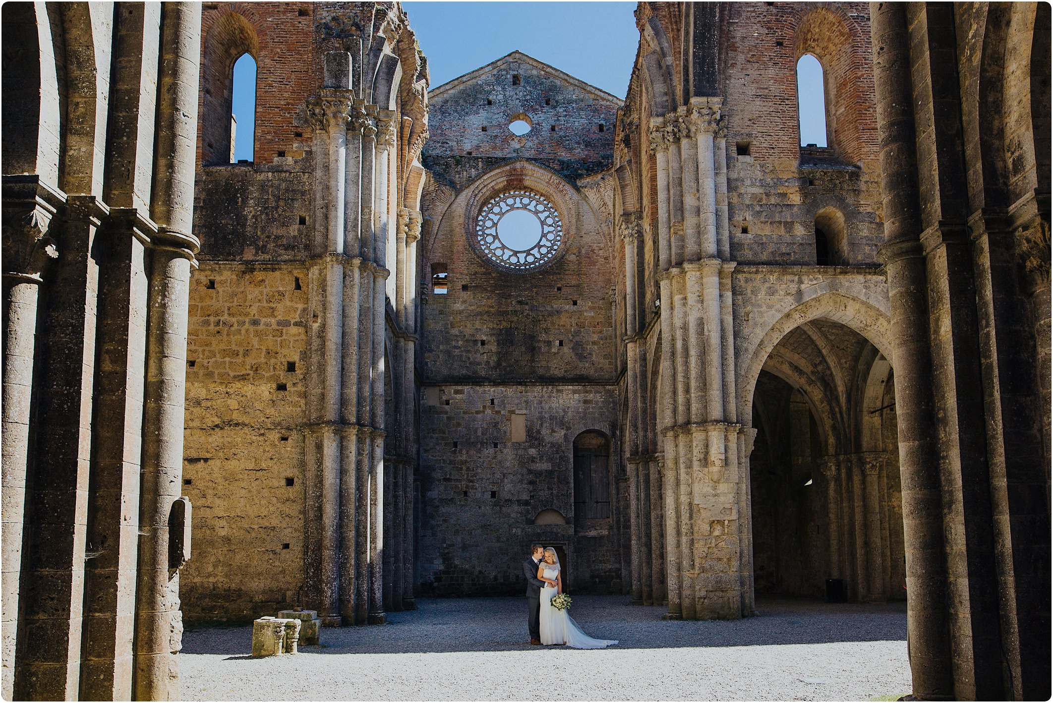 bride and groom in an empty san galgano abbey wedding