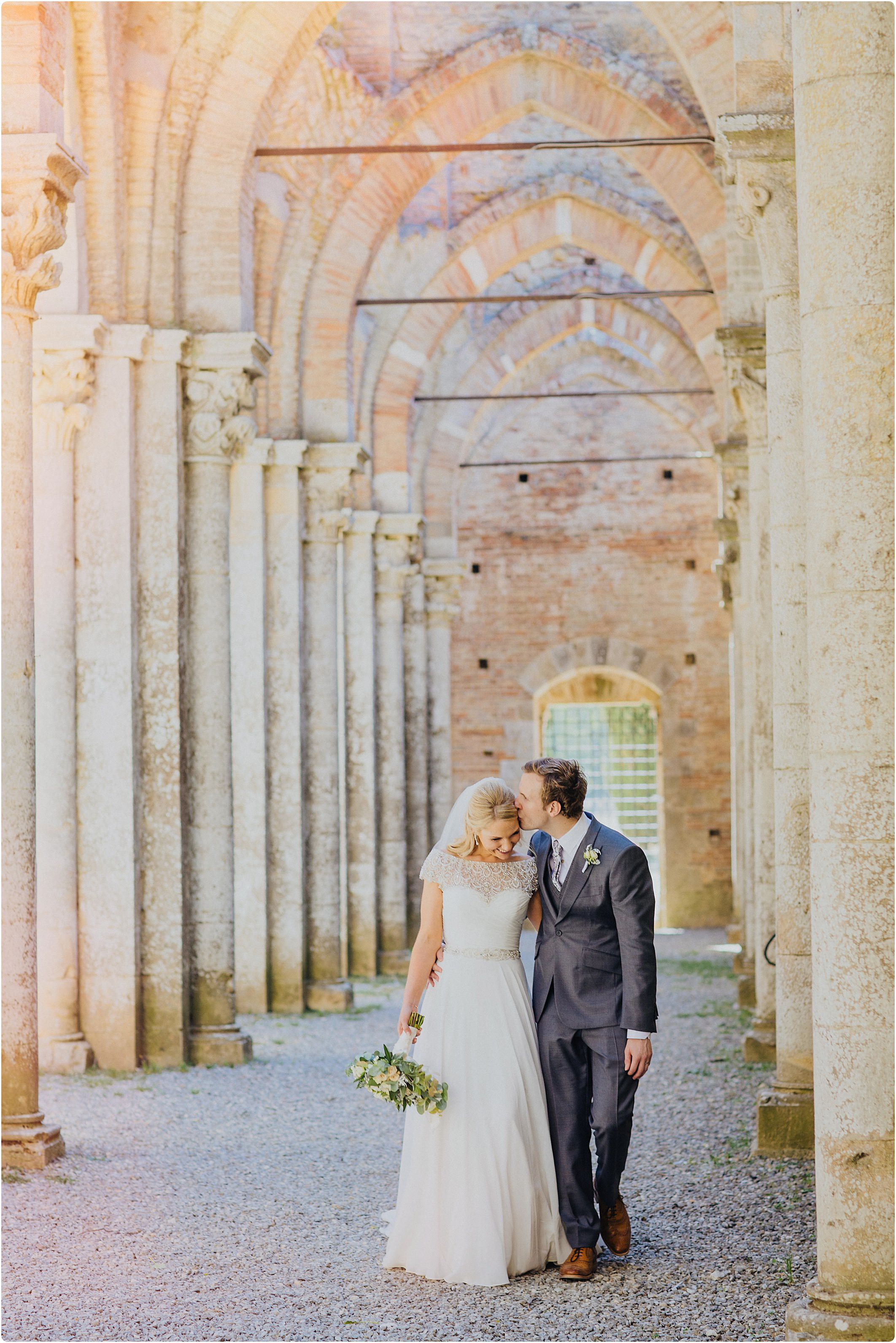 bride and groom walking together at a san galgano abbey wedding