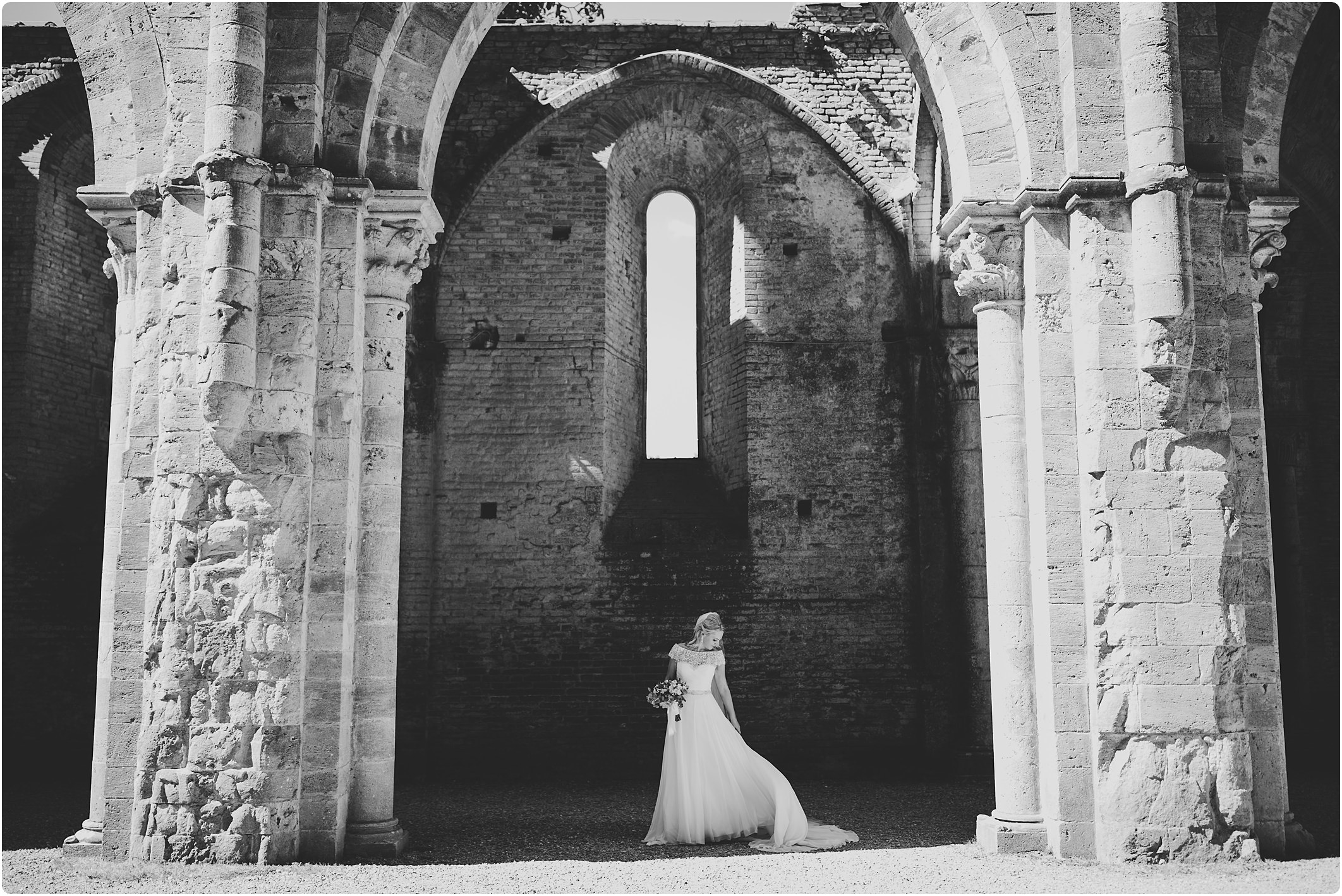 bride in black and white in justin alexander dress at a san galgano abbey wedding