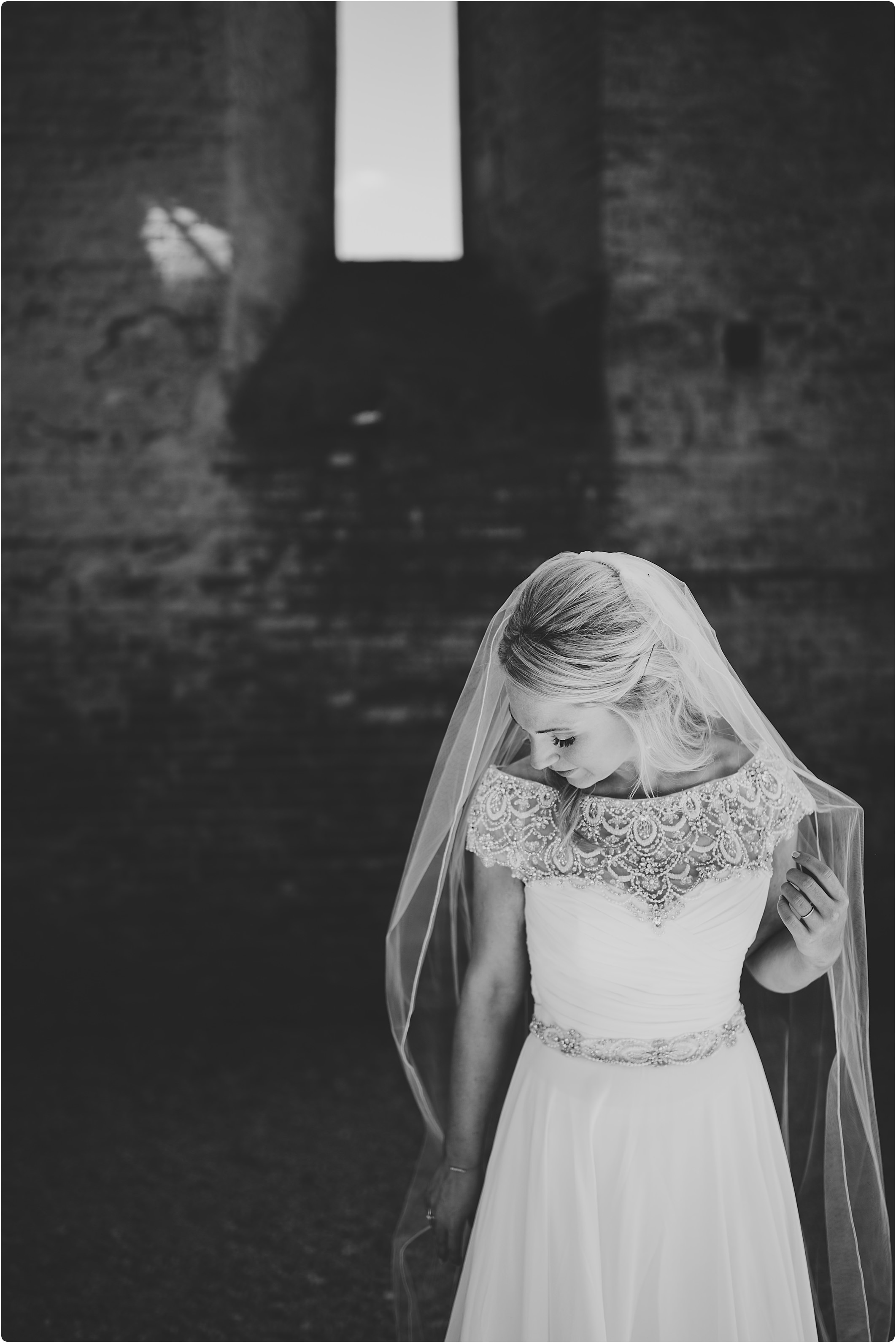 blak and white of bride in justin alexander dress at a san galgano abbey wedding