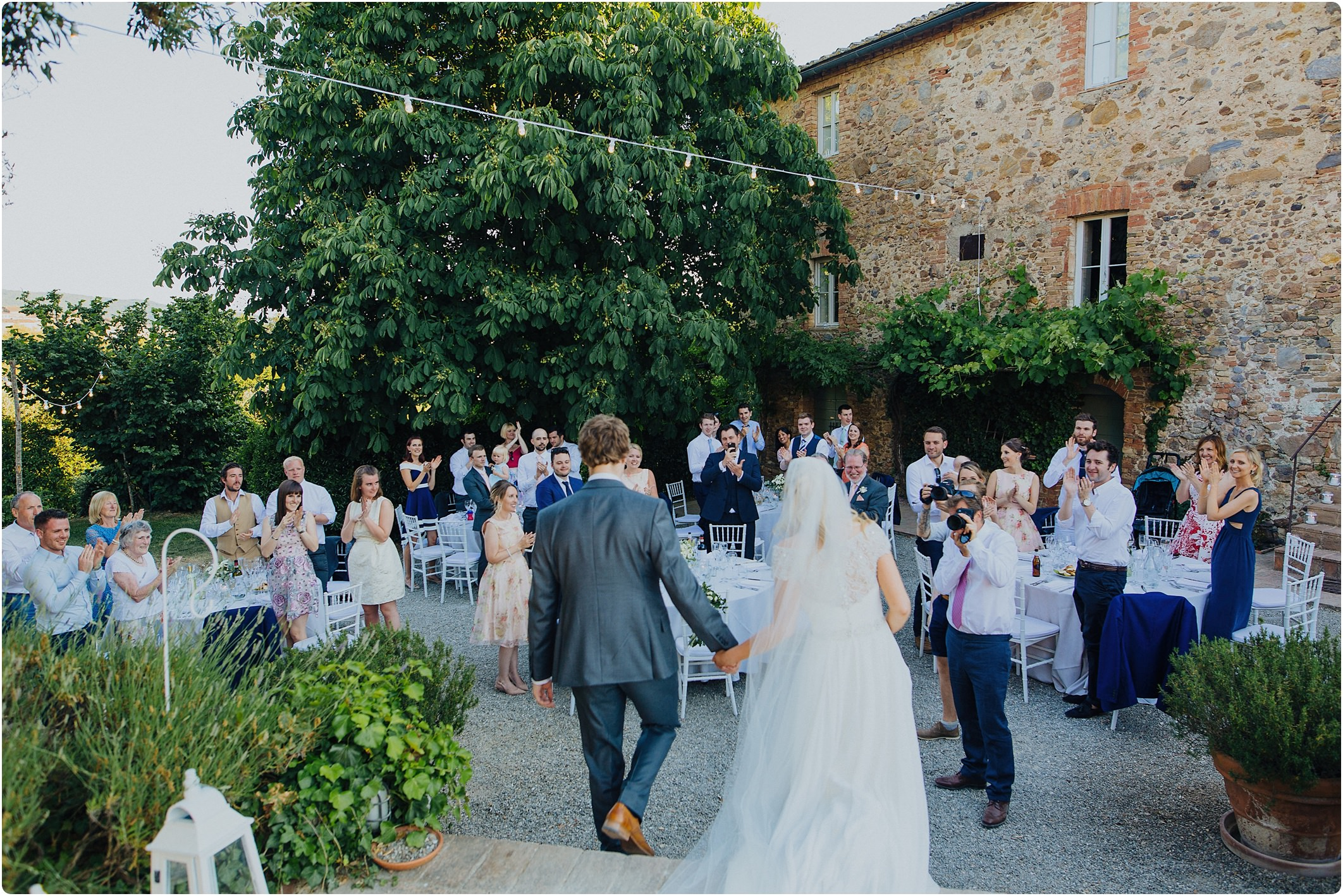 bride and groom walking in at a tuscan wedding