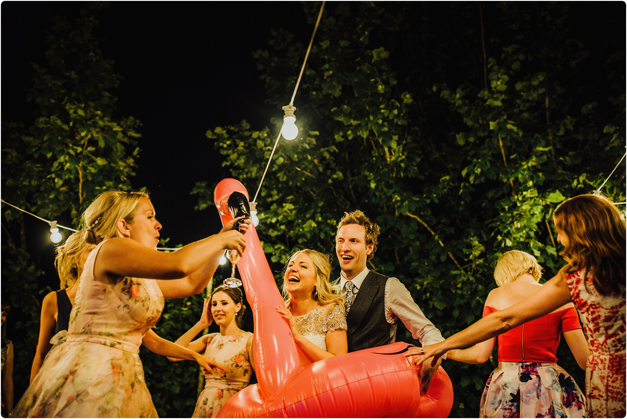 bride and groom in a pink flamingo at a villa podernovo wedding