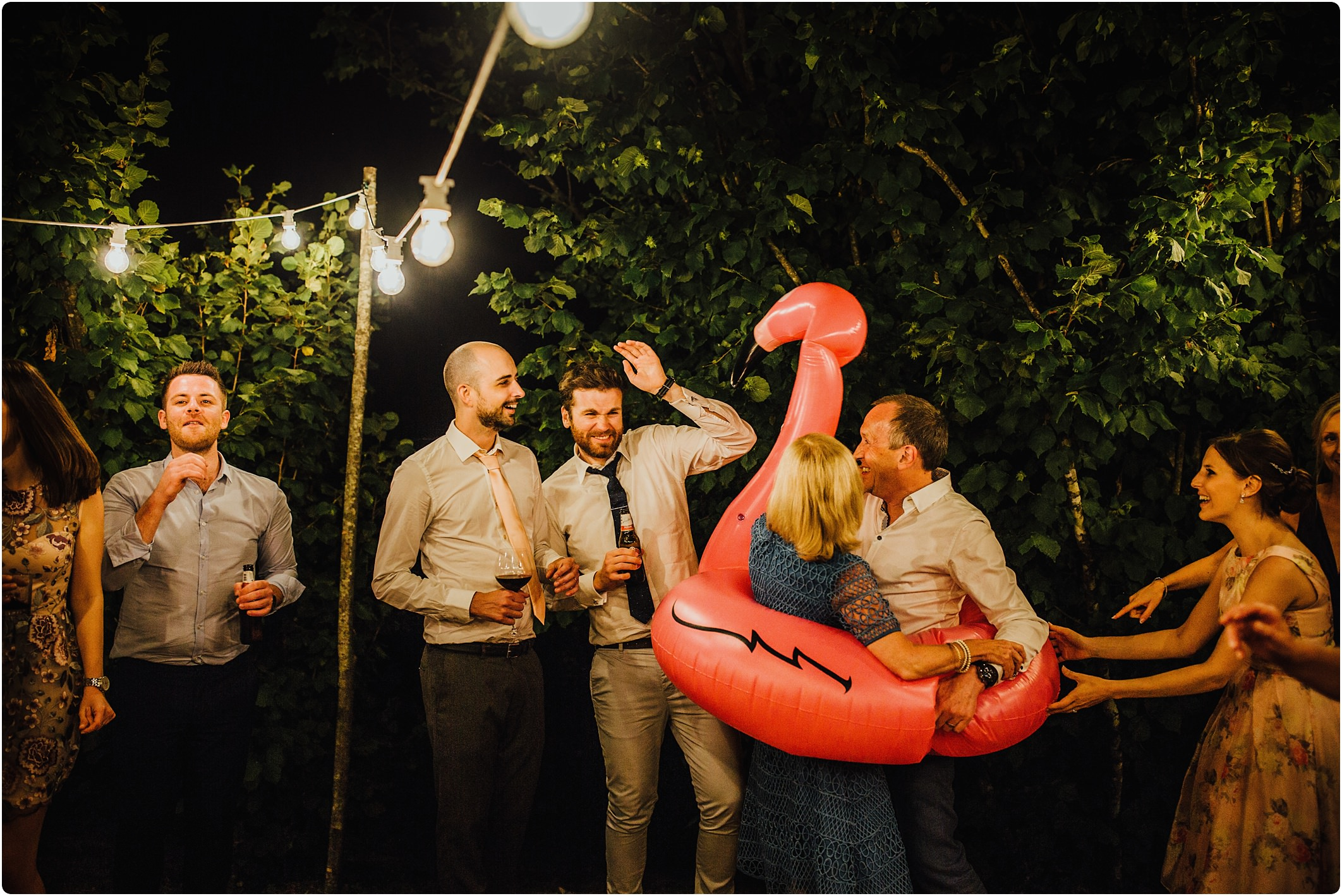 pink flamingo dancing at a villa podernovo wedding