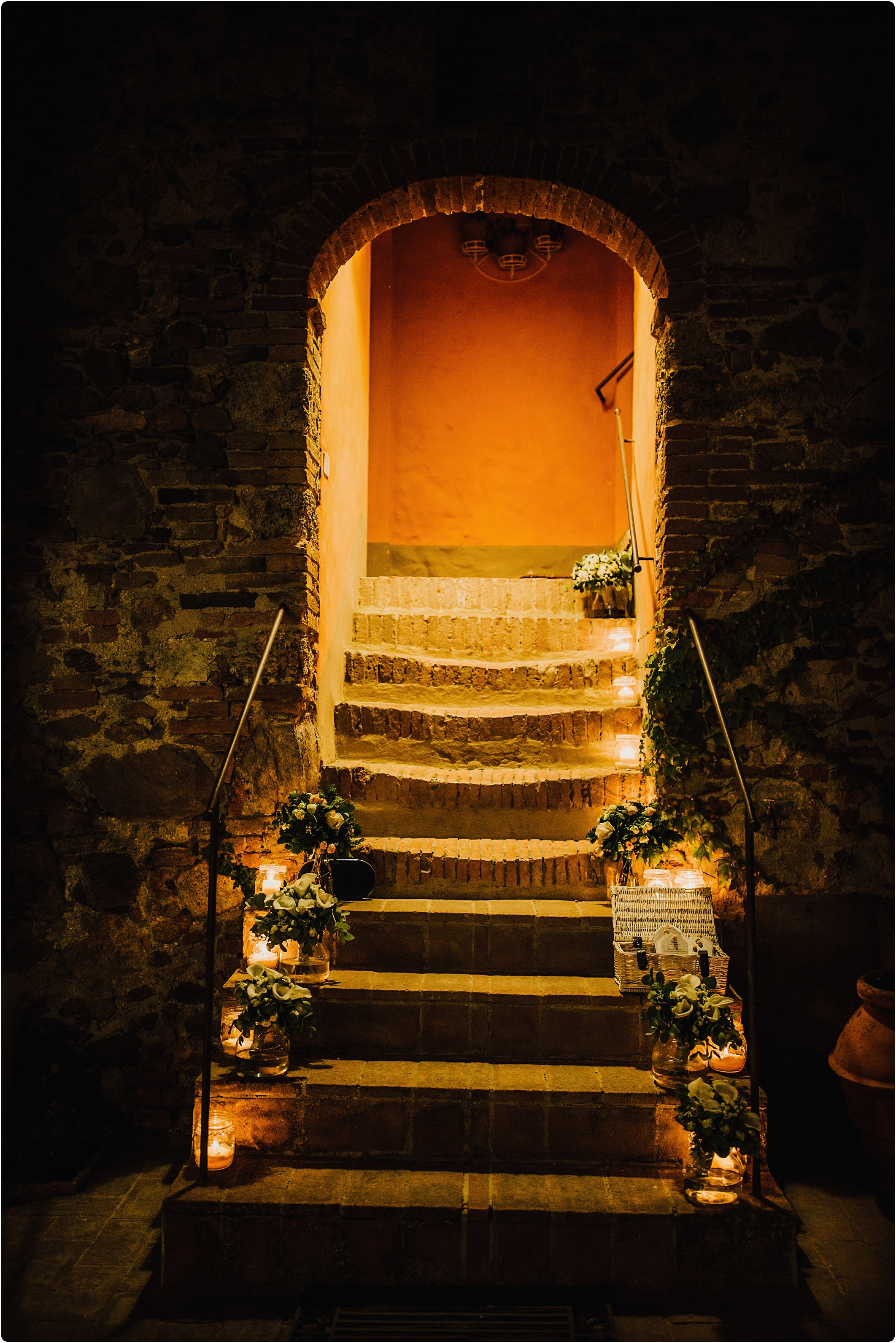 candles on tuscan stairs