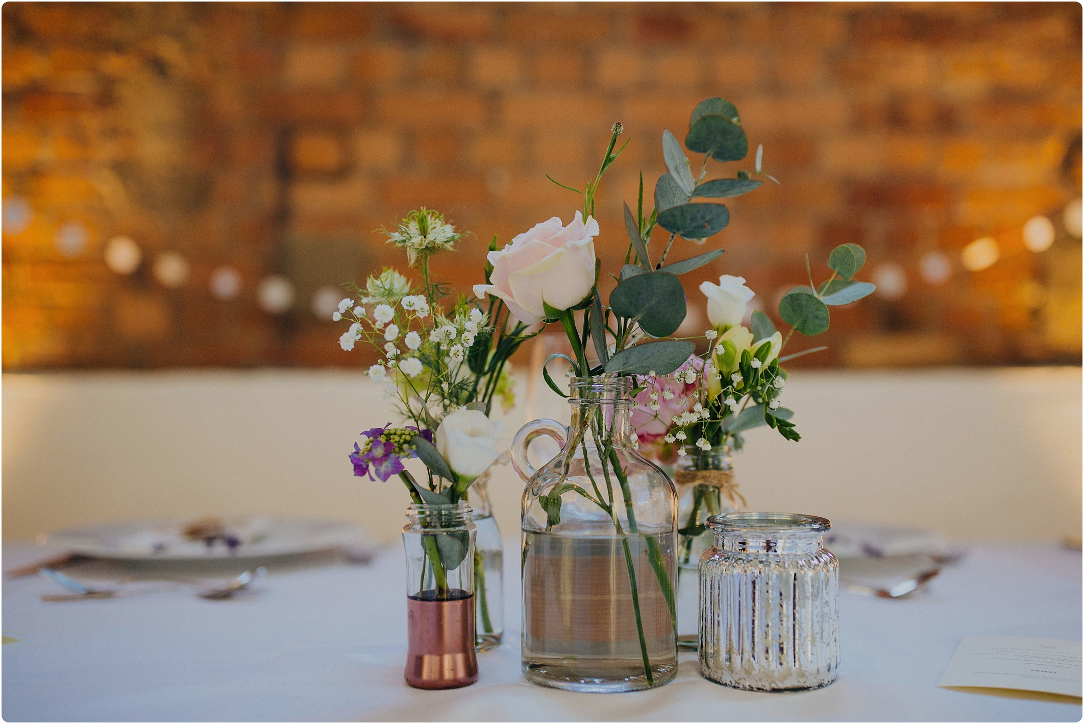 bronze and rose table centre The Paintworks Wedding