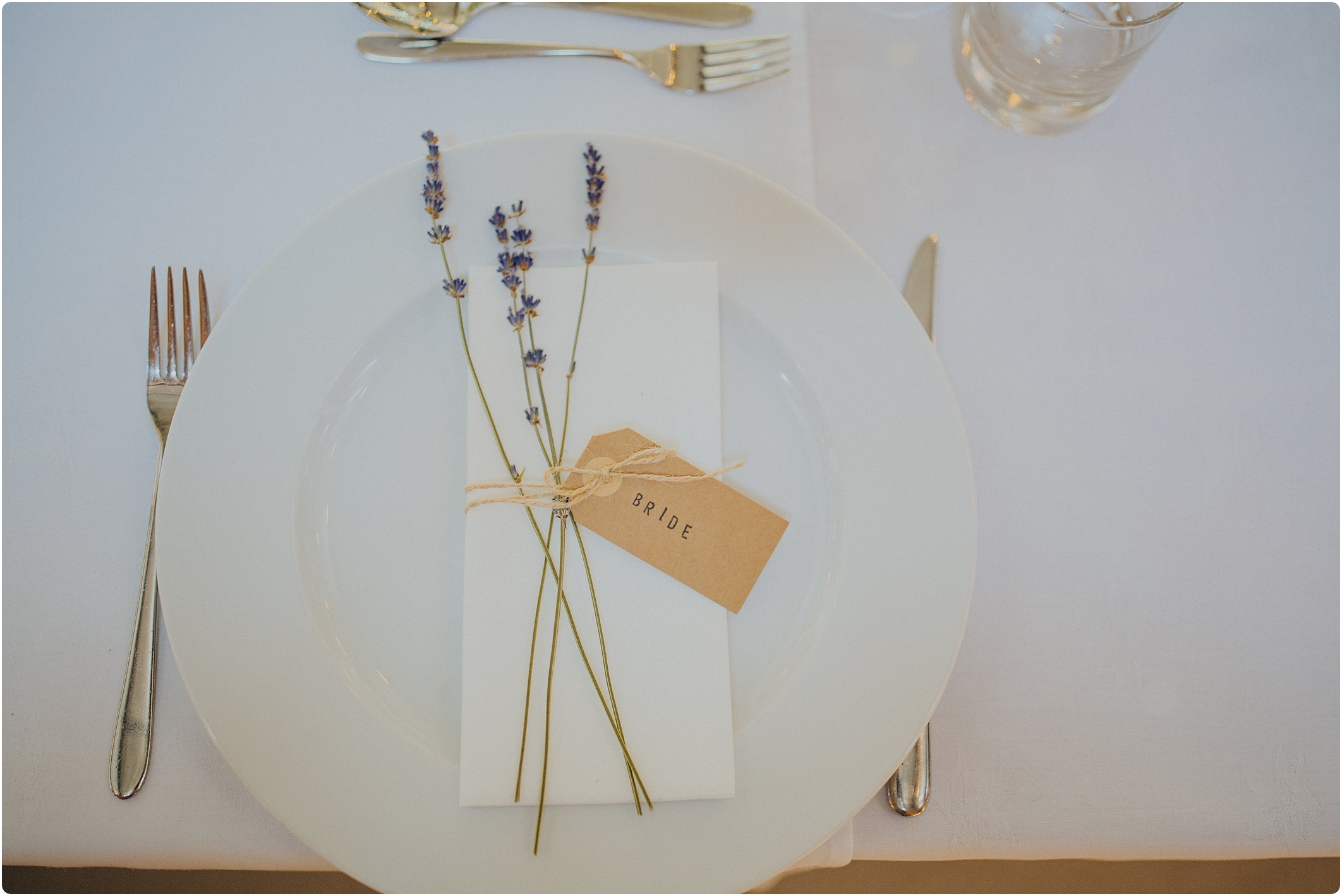 simple rustic lavender and luggage lable name card at The Paintworks Wedding