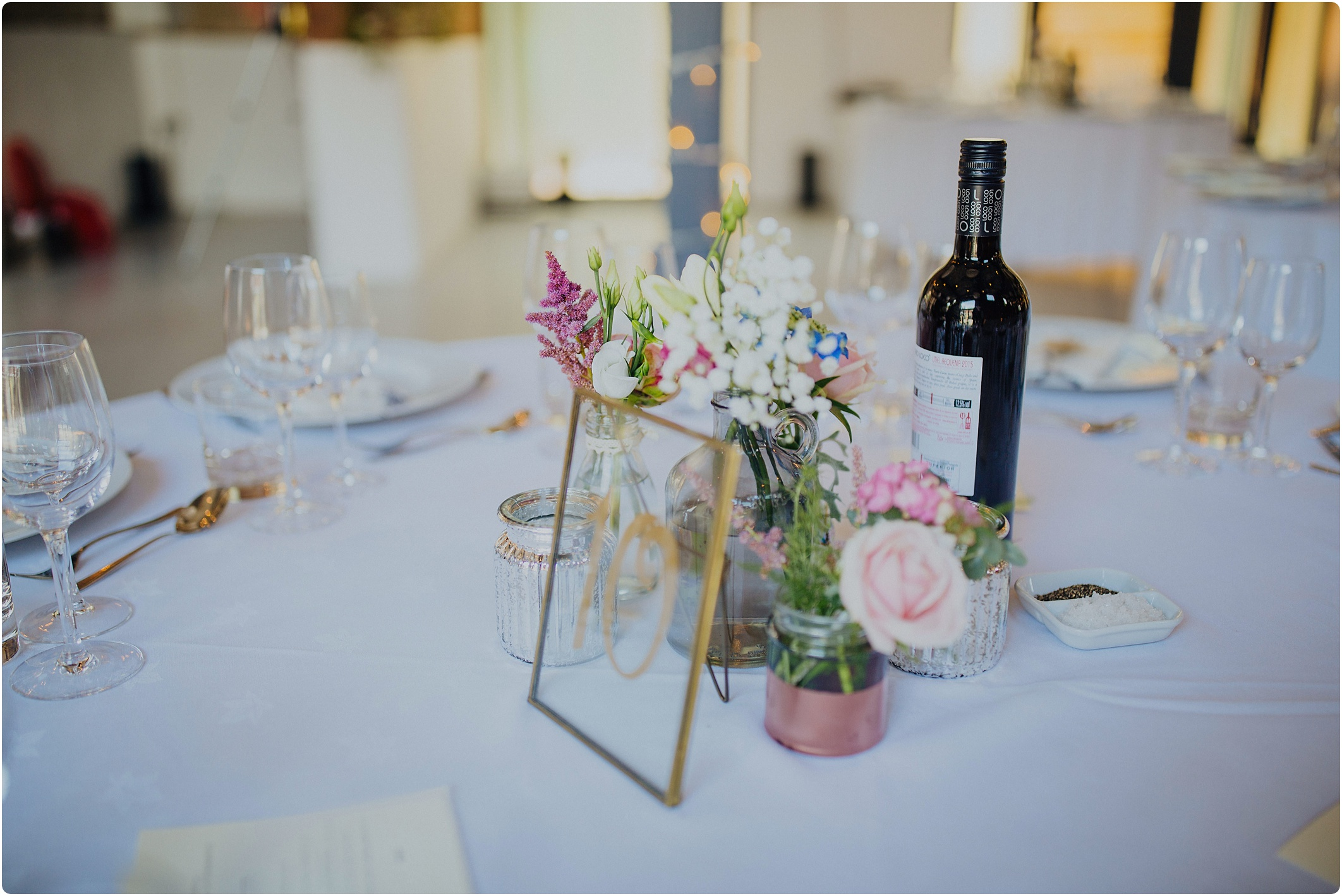 gold glass table numbers at a The Paintworks Wedding