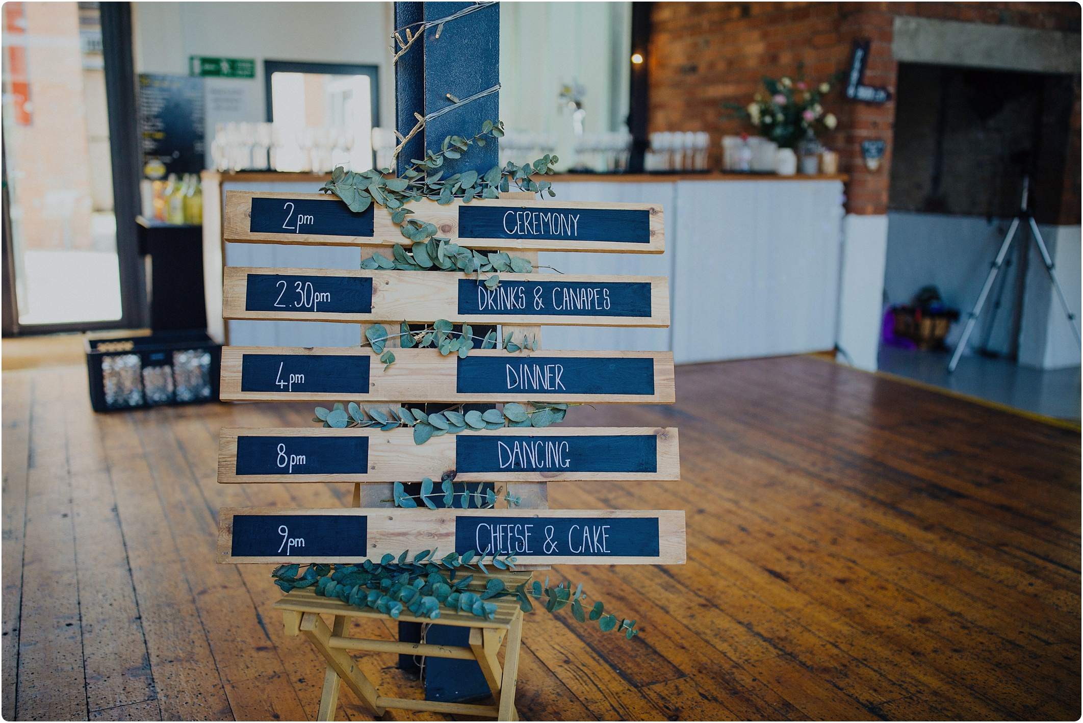 chalk board and pallet day timings at The Paintworks Wedding