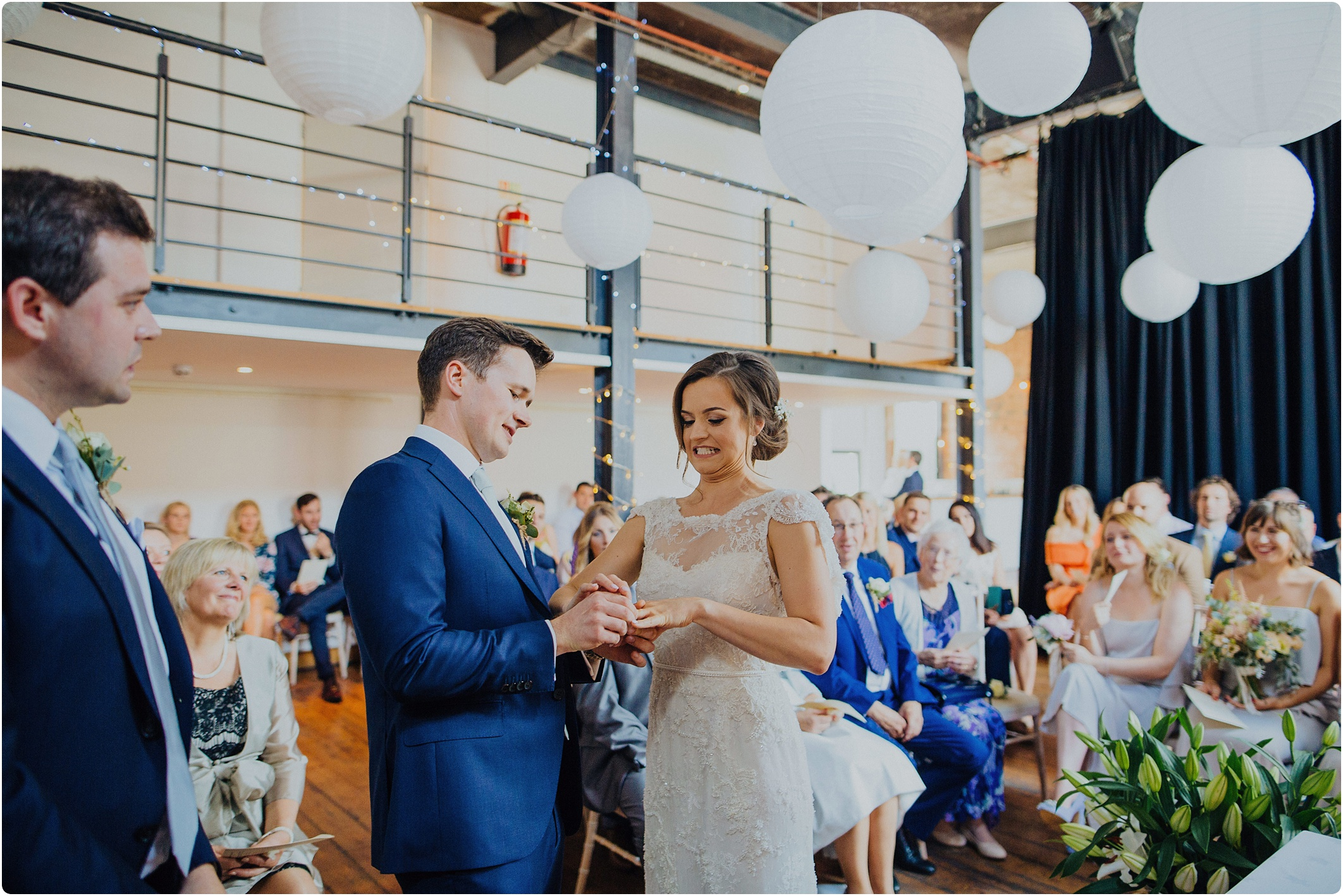 exchanging rings at The Paintworks Wedding