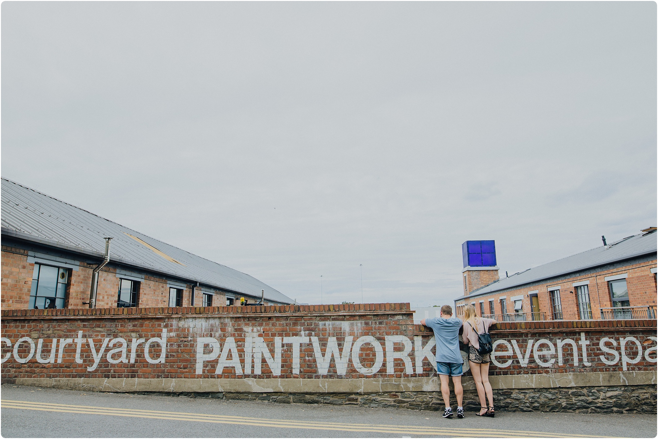 couple looking over wall at The Paintworks Wedding