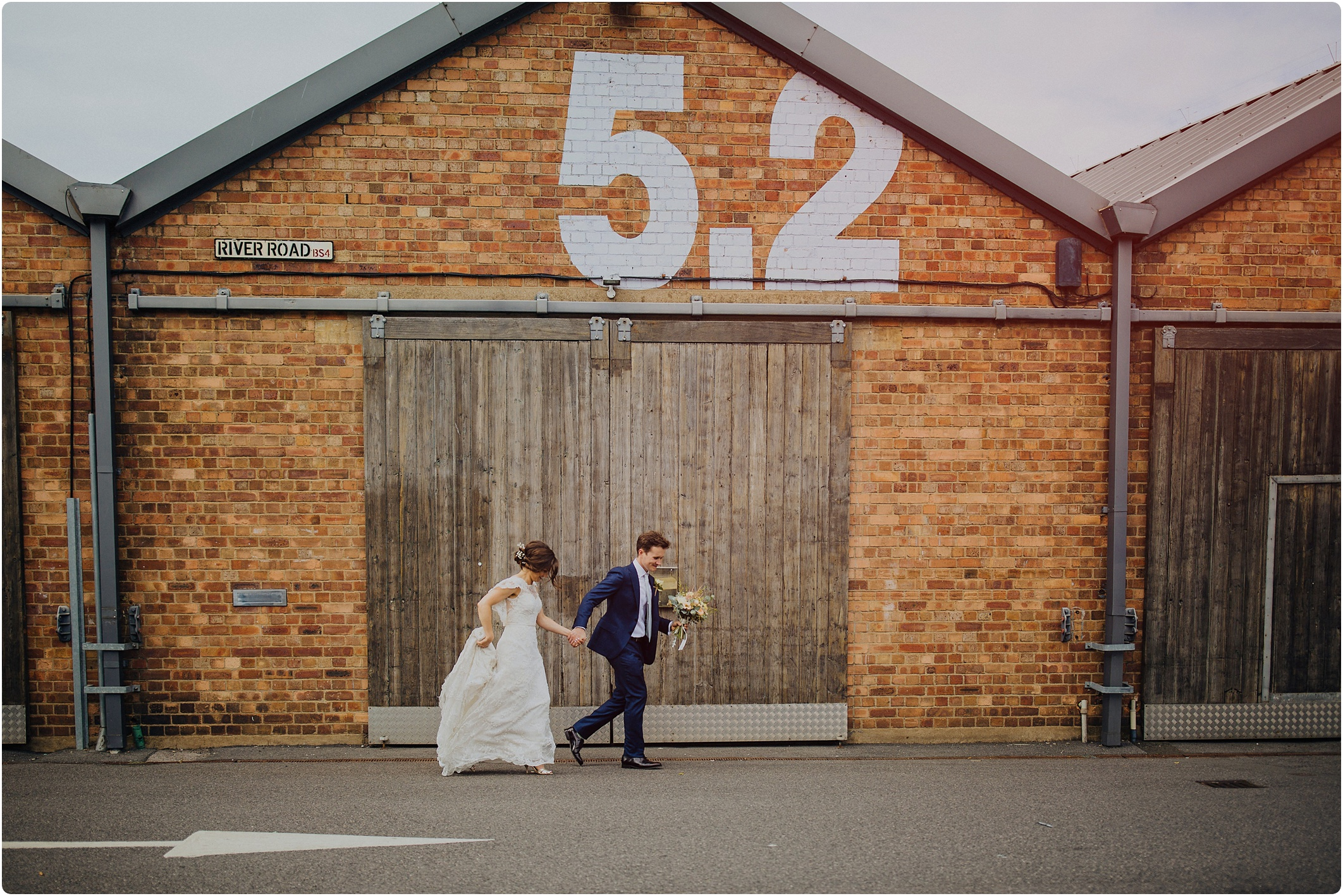 couple running at The Paintworks Wedding