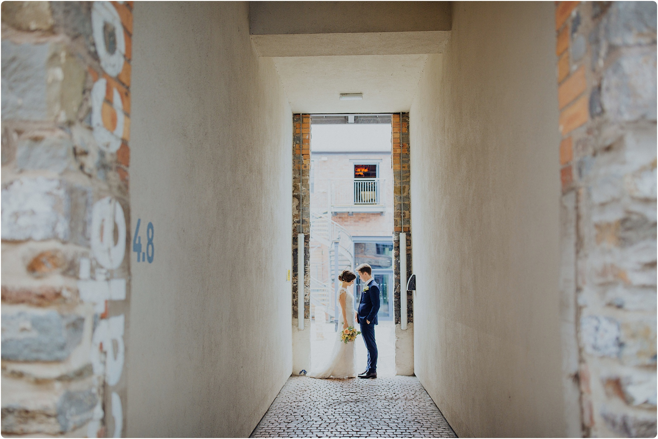 couple in the alley at a The Paintworks Wedding
