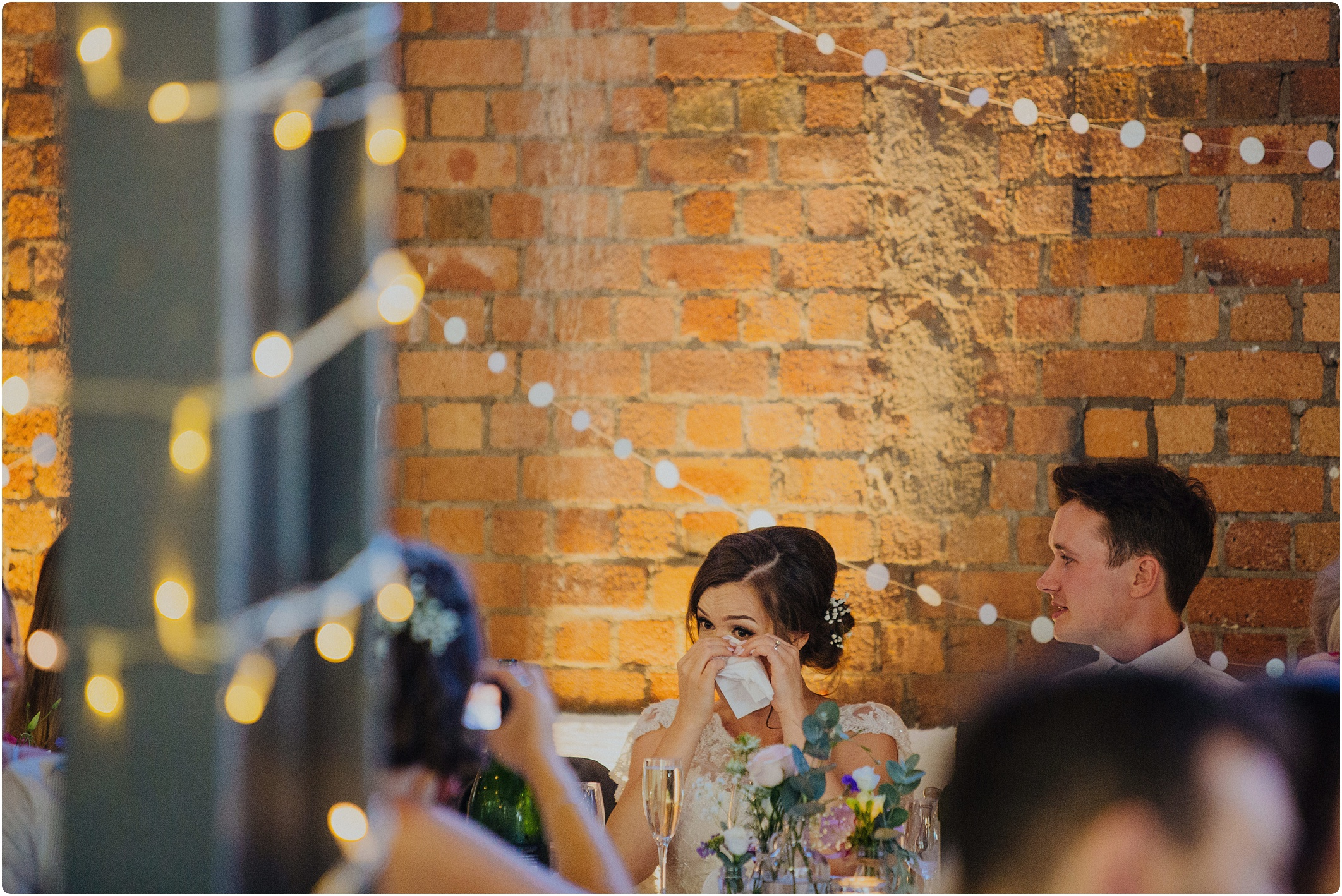 bride wiping tears at a The Paintworks Wedding