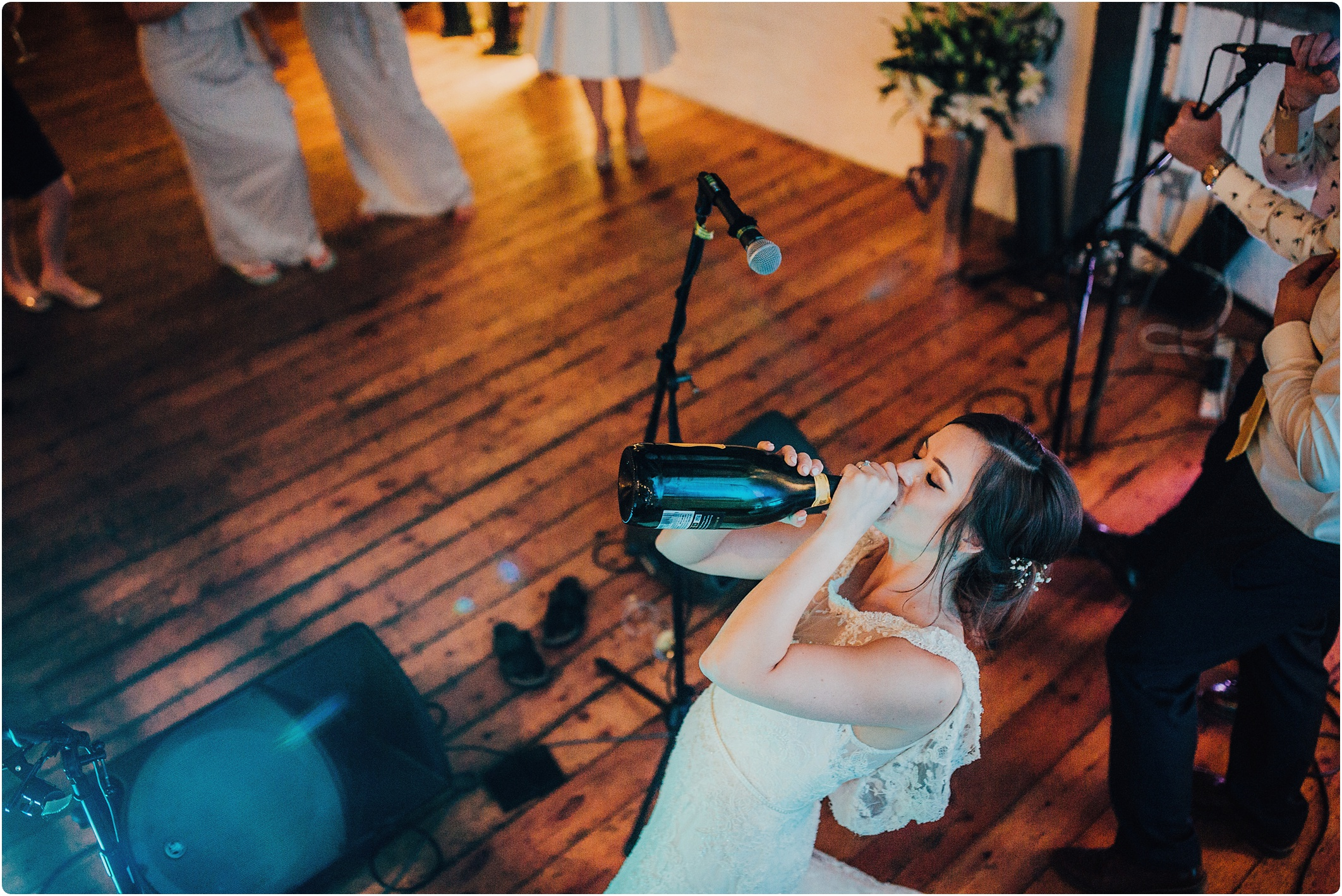 bride swinging champagne at a paintowrks wedding